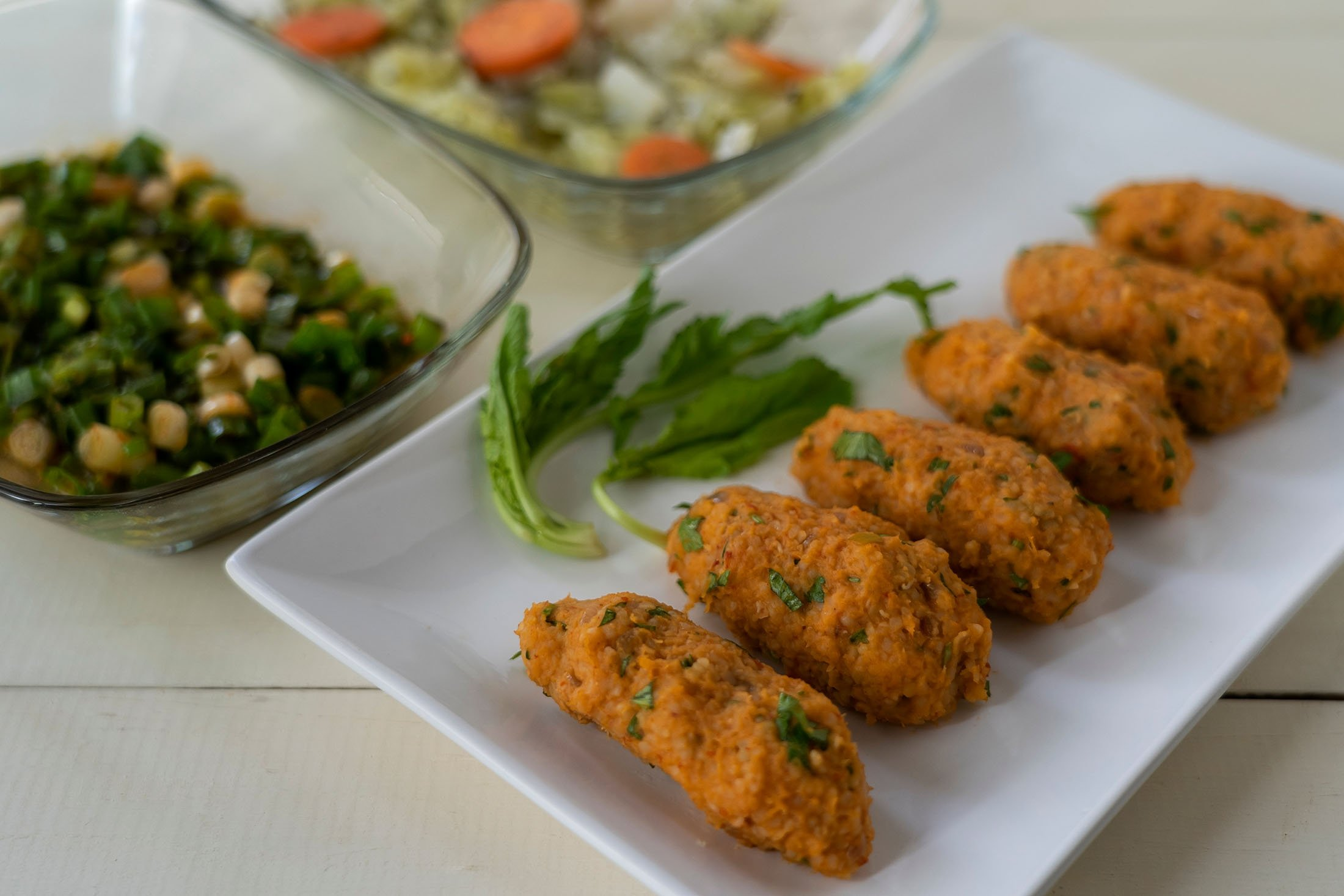 """""""Mercimek köftesi,"""" a red lentil patty filled with tomatoes and spices that is shaped by hand into finger-food-sized oblong shapes. (Shutterstock Photo)"""