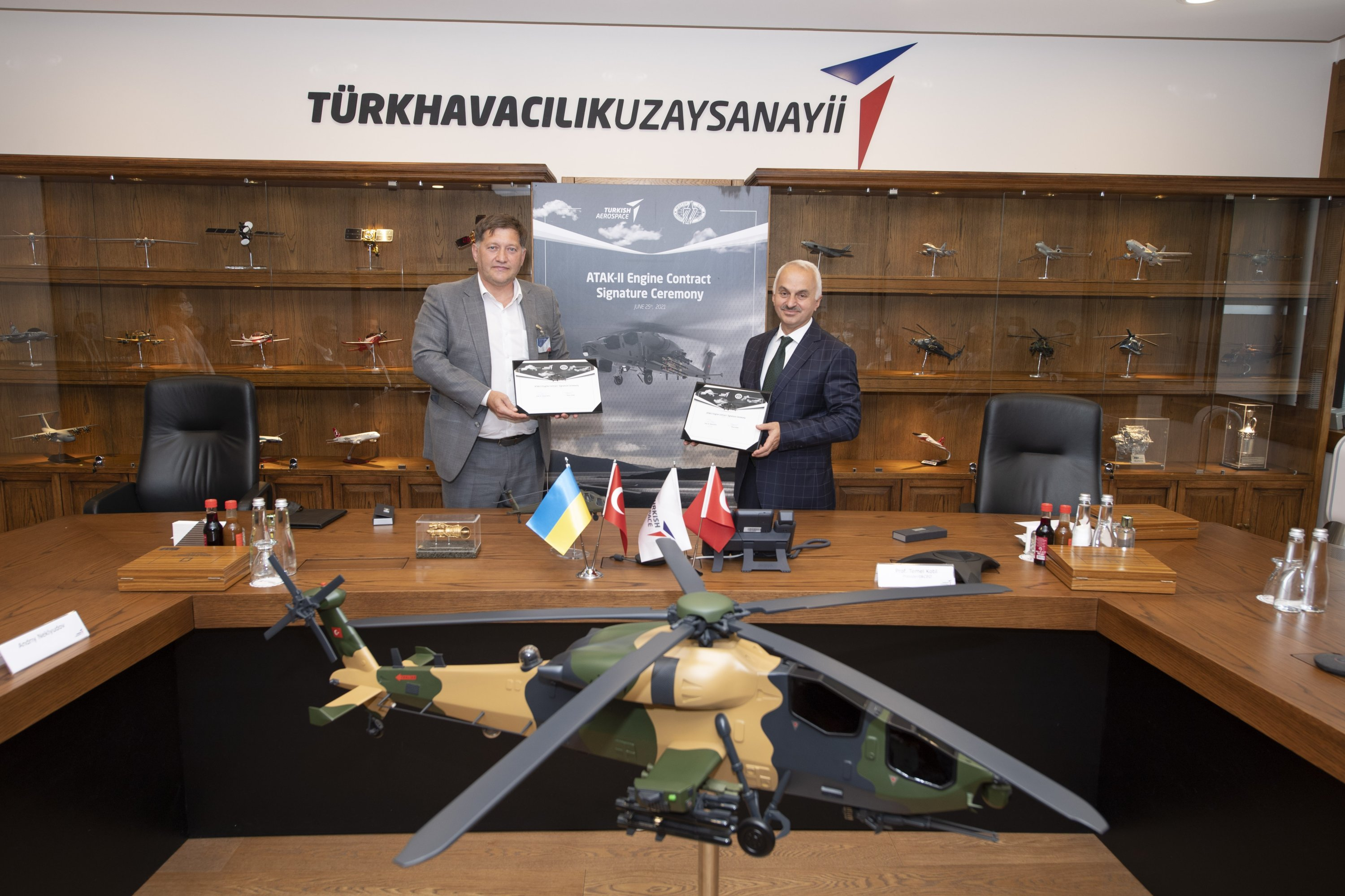 Officials from TAI, Motor Sich seen during the signing of the engine procurement deal, Ankara, Turkey, June 29, 2021. (IHA Photo)
