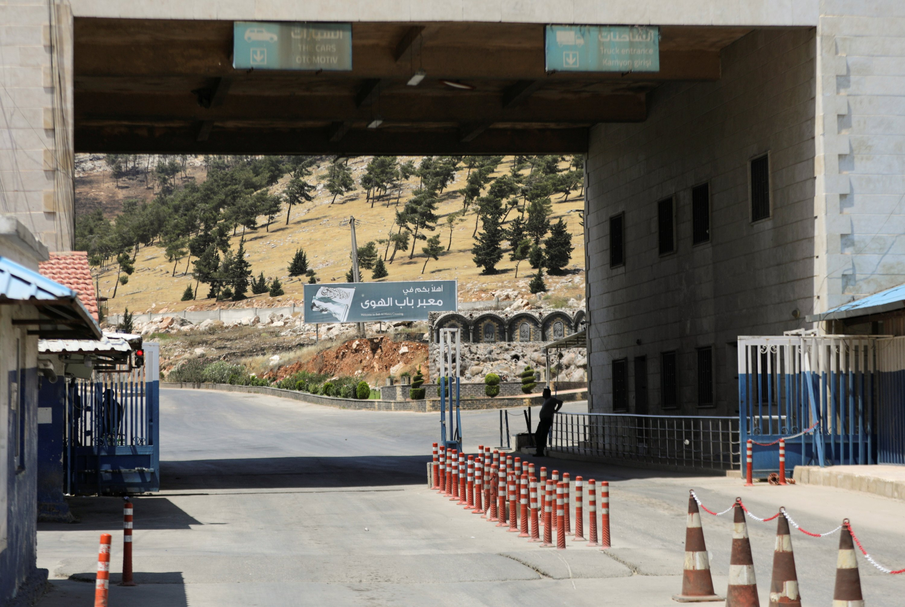 A road sign that reads 'Welcome to Bab al-Hawa crossing' is seen at Bab al-Hawa crossing at the Syrian-Turkish border, in Idlib governorate, northwestern Syria, June 10, 2021. (REUTERS Photo)