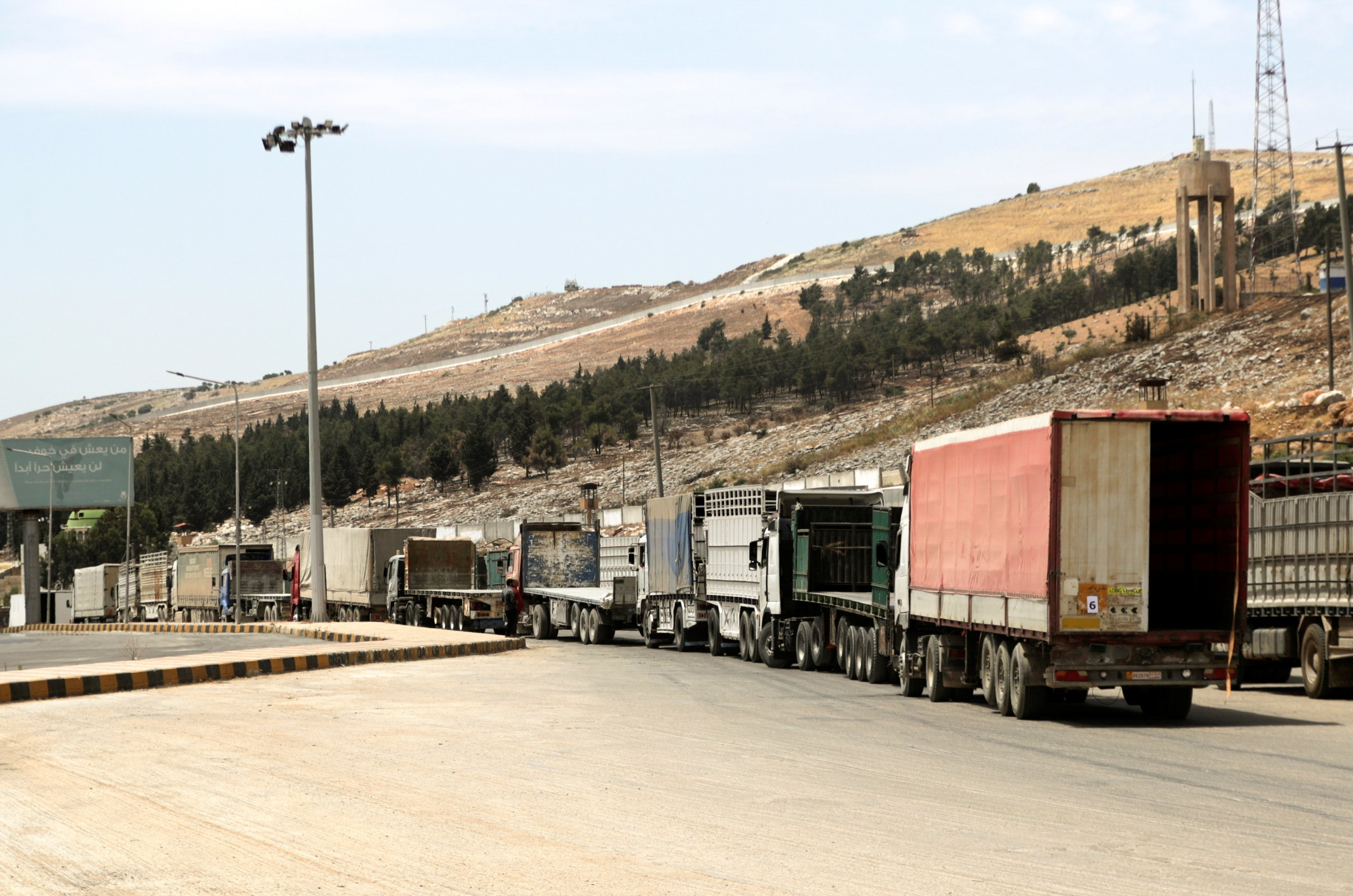 Vehicles wait at Bab al-Hawa crossing at the Syrian-Turkish border, in Idlib governorate, northwestern Syria, June 10, 2021. (REUTERS Photo)