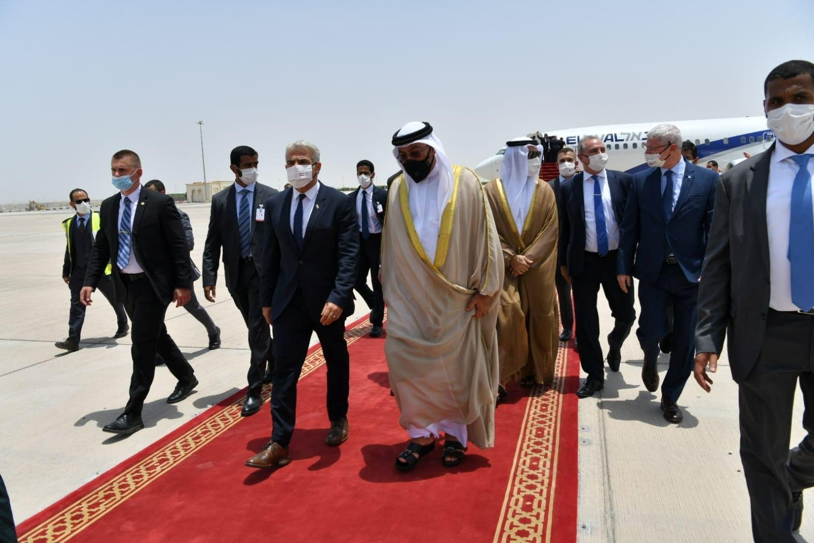 United Arab Emirates Minister of State Ahmed Ali Al Sayegh (R) welcomes Israeli Foreign Minister Yair Lapid (L) at Abu Dhabi Airport, UAE, June 27, 2021. (Shlomi Amsalem/Government Press Office (GPO) via Reuters)