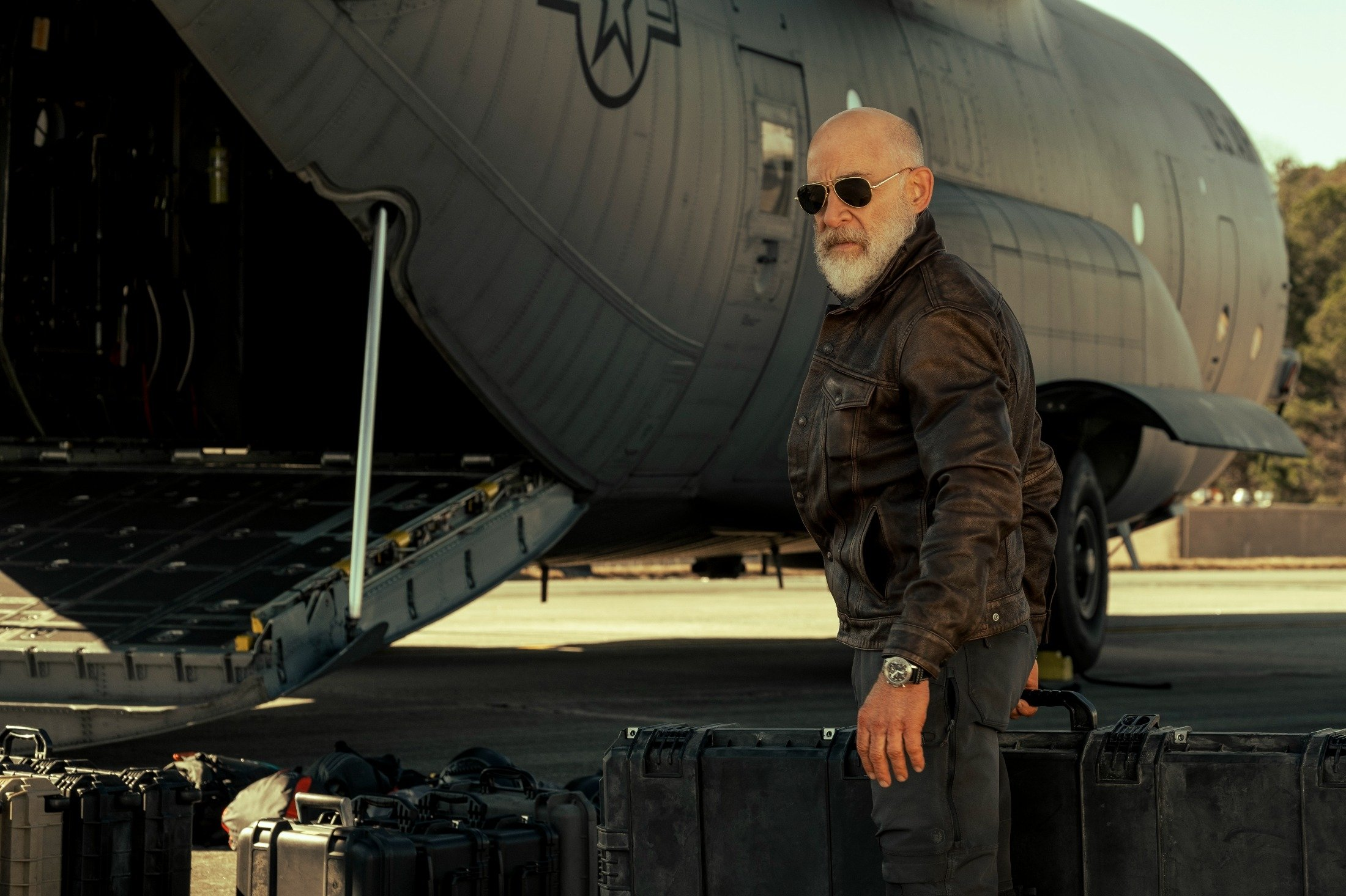 J. K. Simmons stands behind a military cargo plane, in a scene from 'The Tomorrow War.' (Amazon via AP)