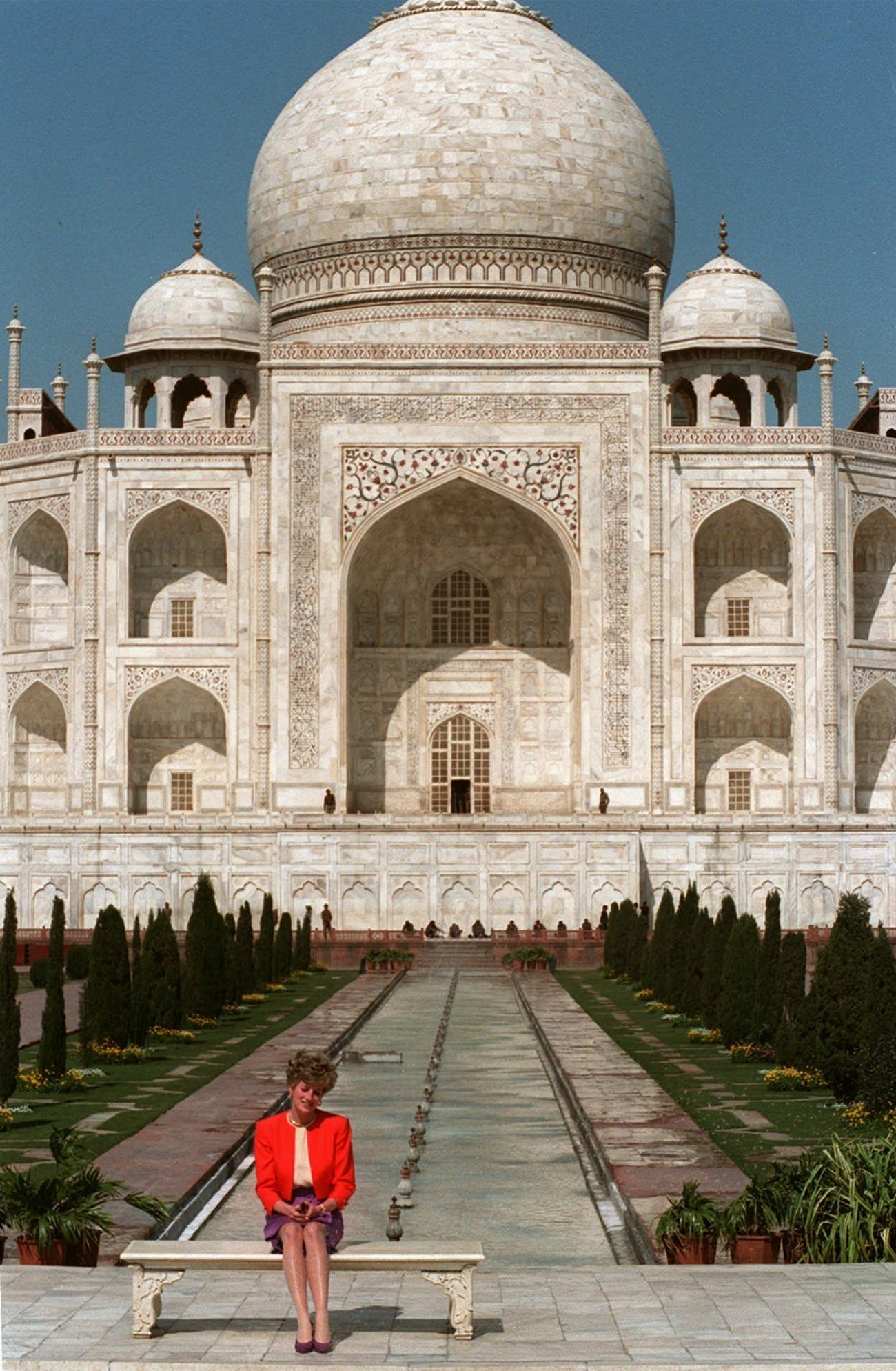 Britain's Princess Diana sits alone backdropped by the Taj Mahal in Agra, India, Feb. 11, 1992. (AP Photo)