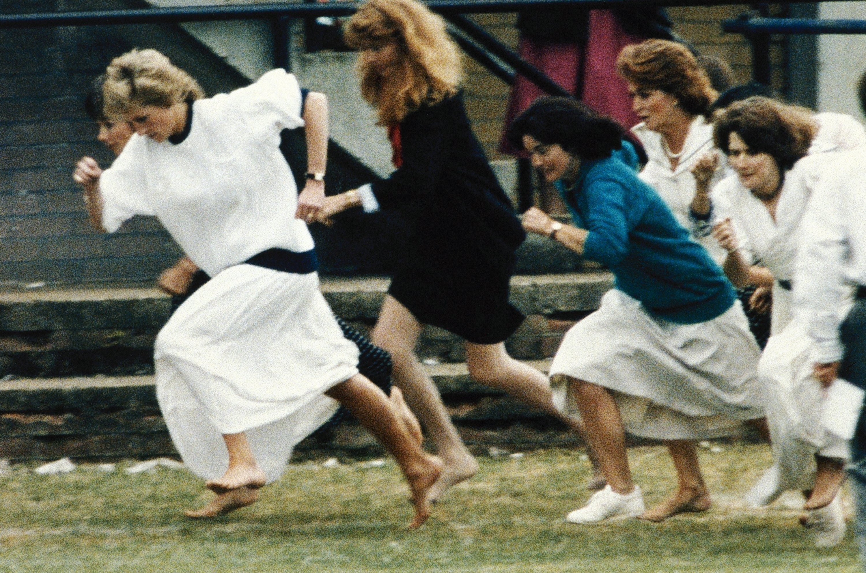 Britain's Princess Diana wearing a white dress, races ahead during the mother's race, held during a sports day for Wetherby school, where her son Prince William is a pupil, London, U.K., June 28, 1989. (AP Photo)