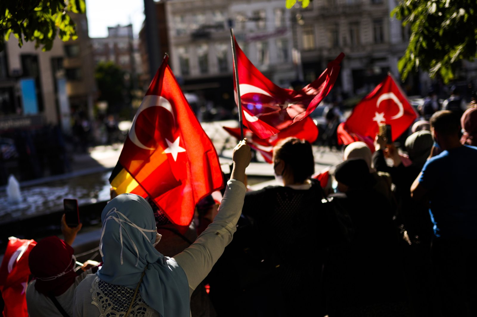 Supporters wave Turkish flags as Turkey's President Recep Tayyip Erdoğan arrives at the NATO summit in Brussels, Belgium, Sunday, June 13, 2021. (AP Photo)