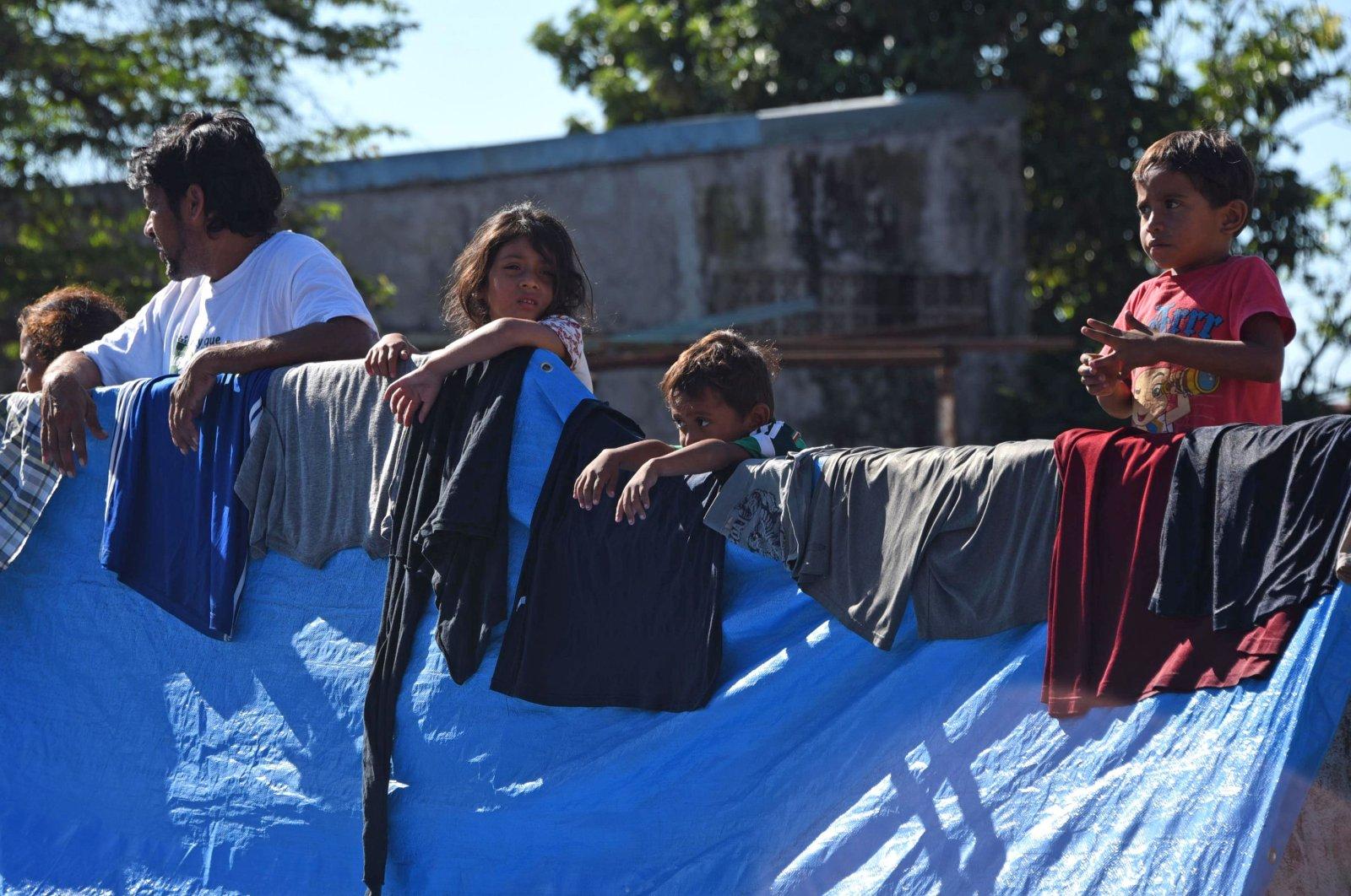 Honduran migrants taking part in a caravan heading to the U.S. camp, Huixtla, Chiapas State, Mexico, Oct. 23, 2018. (AFP Photo)