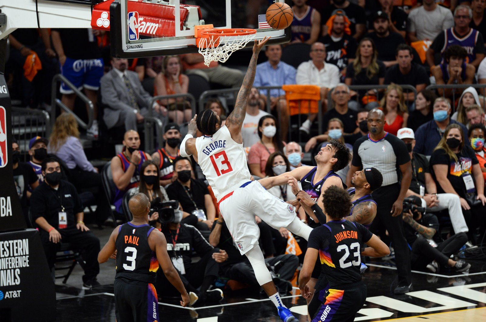 LA Clippers guard Paul George (C) puts up a layup against the Phoenix Suns during the 2021 NBA Playoffs Western Conference Finals Game 5 at Phoenix Suns Arena, Arizona, U.S., June 28, 2021.