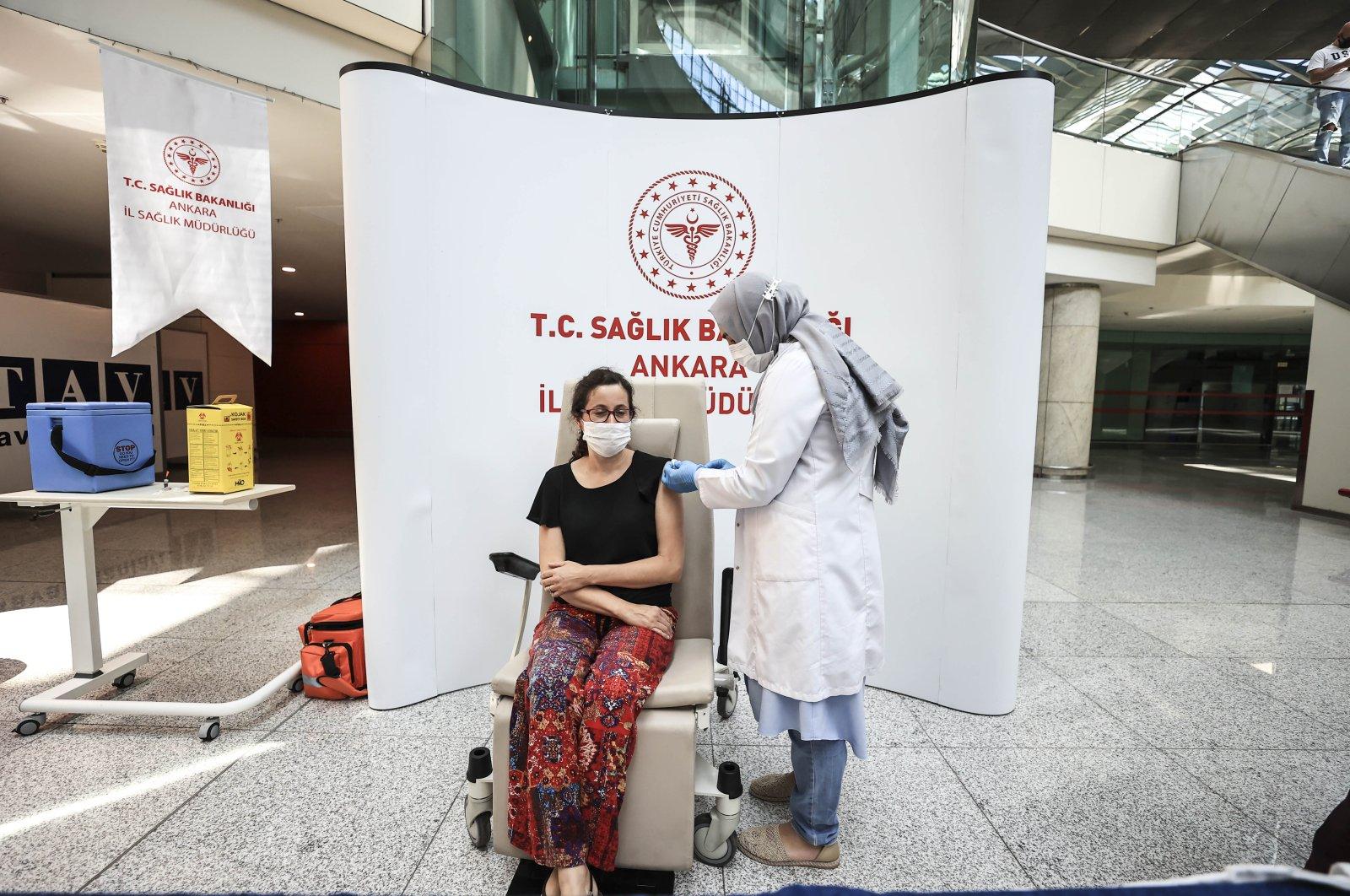 A woman gets vaccinated at a vaccination corner at Esenboğa Airport, Ankara, Turkey, June 29, 2021. (AA PHOTO)