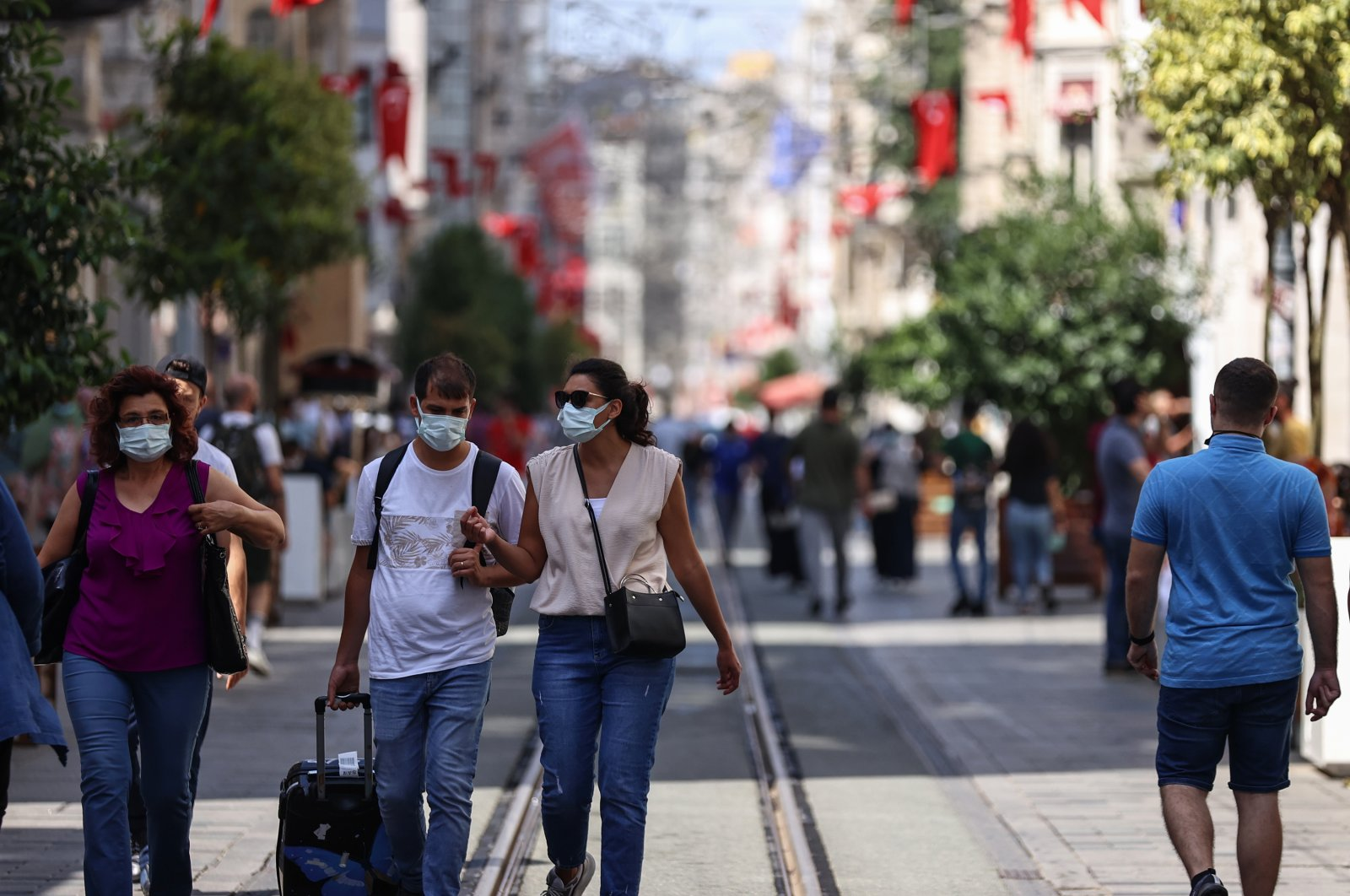People wearing protective masks walk down Istiklal Avenue, in Istanbul, Turkey, June 27, 2021. (AA PHOTO)