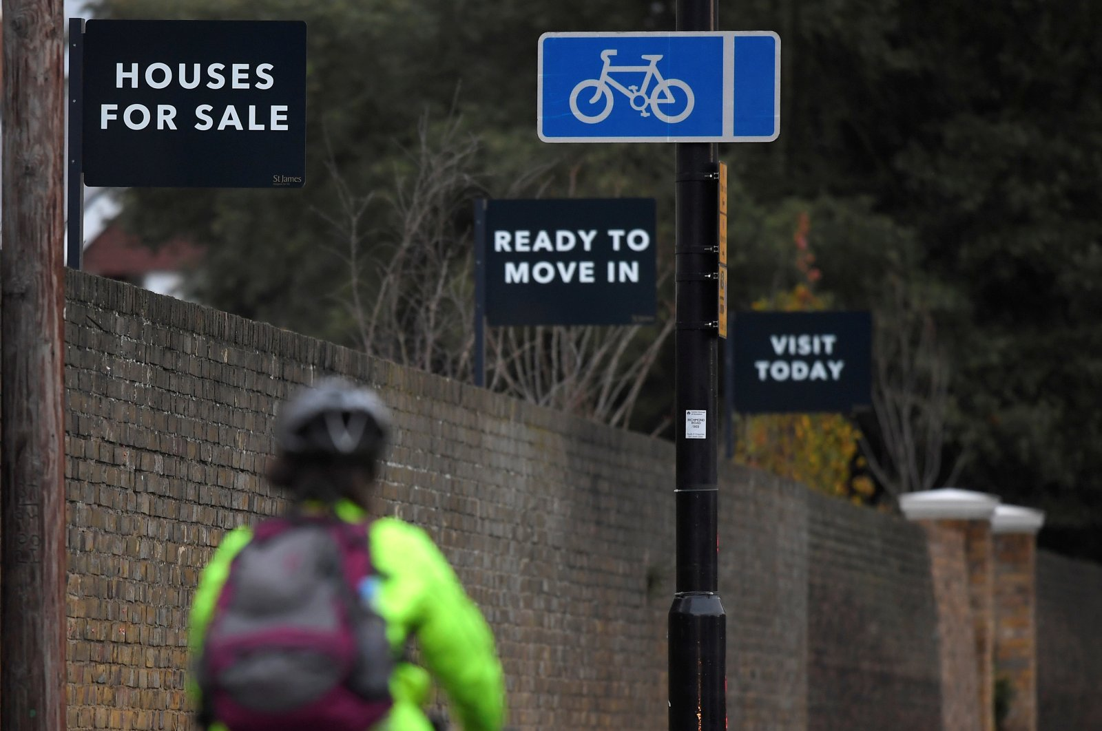 Property sale signs are seen outside of a group of newly built houses in west London, U.K., Nov. 23, 2017. (Reuters Photo)