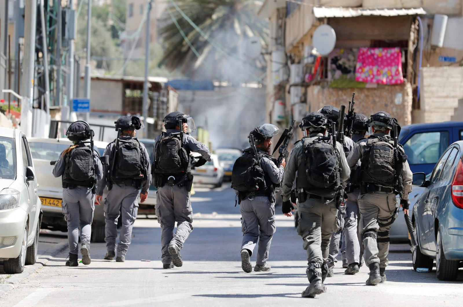 Israeli security officers fire tear gas at Palestinian residents as Israeli authorities demolish shops in Israeli-annexed East Jerusalem's predominantly Arab neighborhood of Silwan, occupied Palestine, June 29, 2021. (AFP Photo)