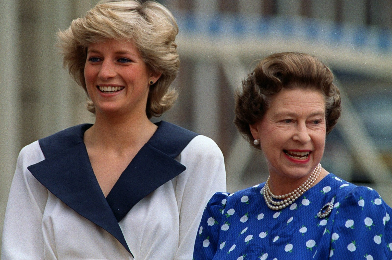 Britain's Diana, Princess of Wales (L), and Britain's Queen Elizabeth II smile to well-wishers outside Clarence House in London, U.K., Aug. 4, 1987. (AP Photo)