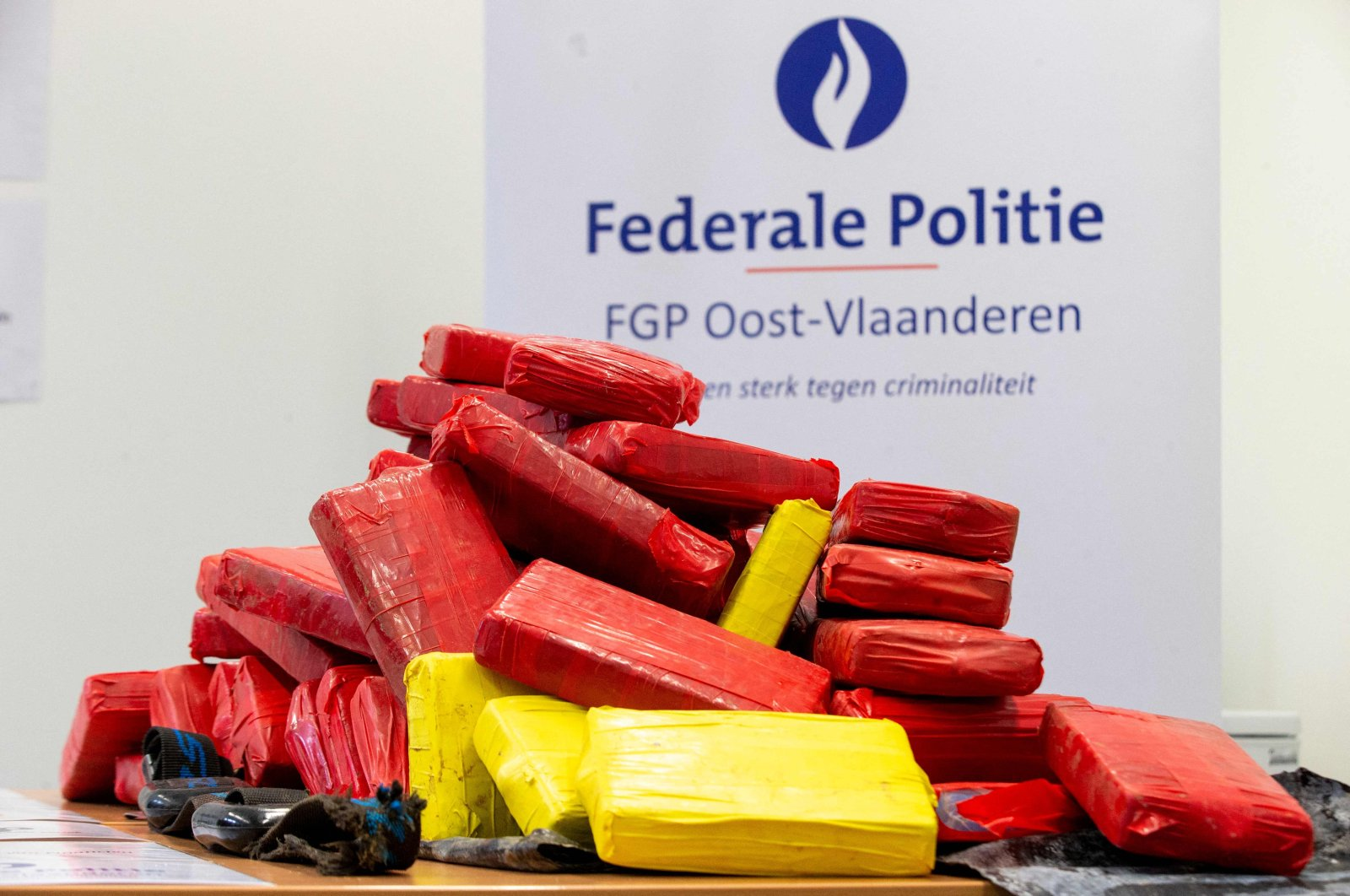 This photograph shows a seizure of some 200 kilograms of cocaine, at the Federal Police East Flanders station, in Dendermonde, Belgium, June 25, 2021. (AFP File Photo)