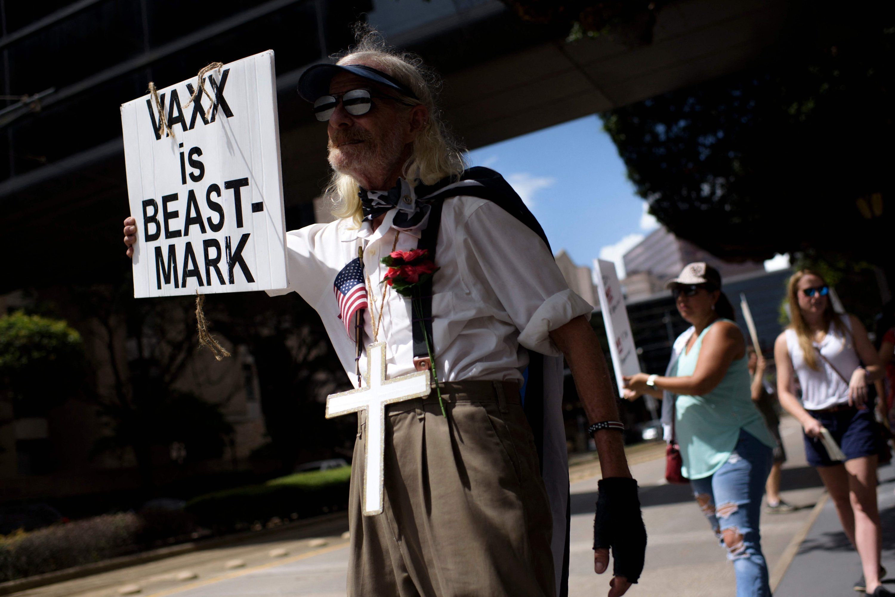 Anti-vaccine rally protesters hold signs outside of Houston Methodist Hospital in Houston, Texas, U.S., June 26, 2021. (AFP Photo)