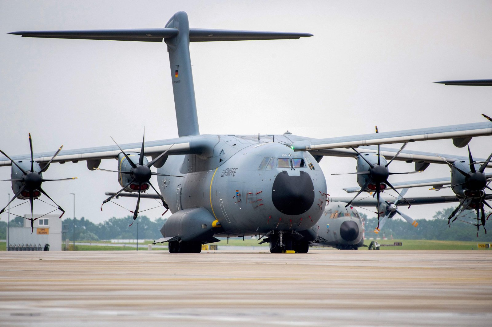 Airbus A400M cargo planes of the German armed forces Bundeswehr stand on the tarmac at the military air base in Wunstorf, northern Germany, on June 30, 2021, as German soldiers returning from Afghanistan are expected to land here. (AFP Photo)