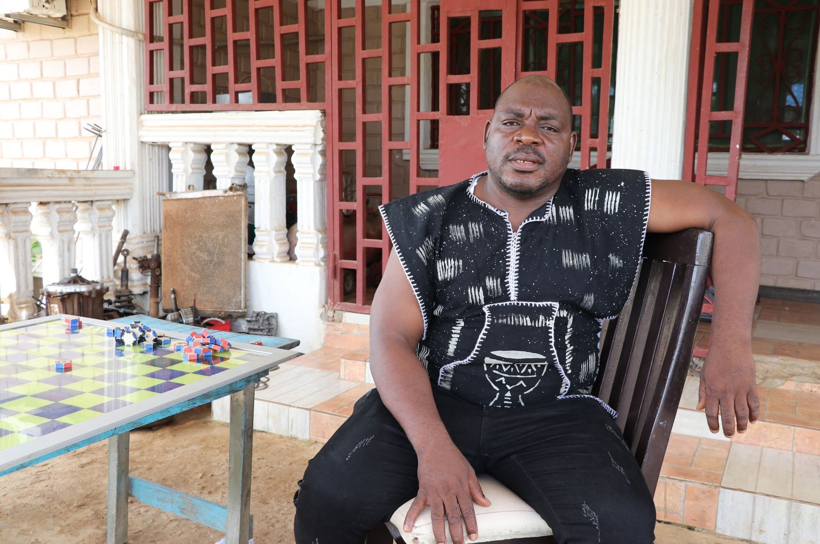 """Former Liberian rebel Joshua Blayhi, also known as """"General Butt Naked,"""" poses for a portrait at his compound in Monrovia, Liberia, June 8, 2021. (AFP Photo)"""