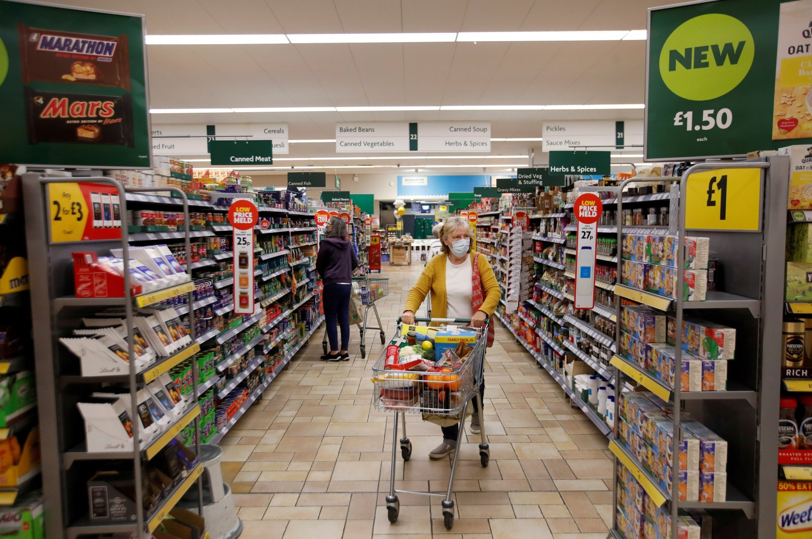 A customer wearing a protective face mask shops at a Morrisons store in St Albans, U.K., Sept. 10, 2020.  (Reuters Photo)