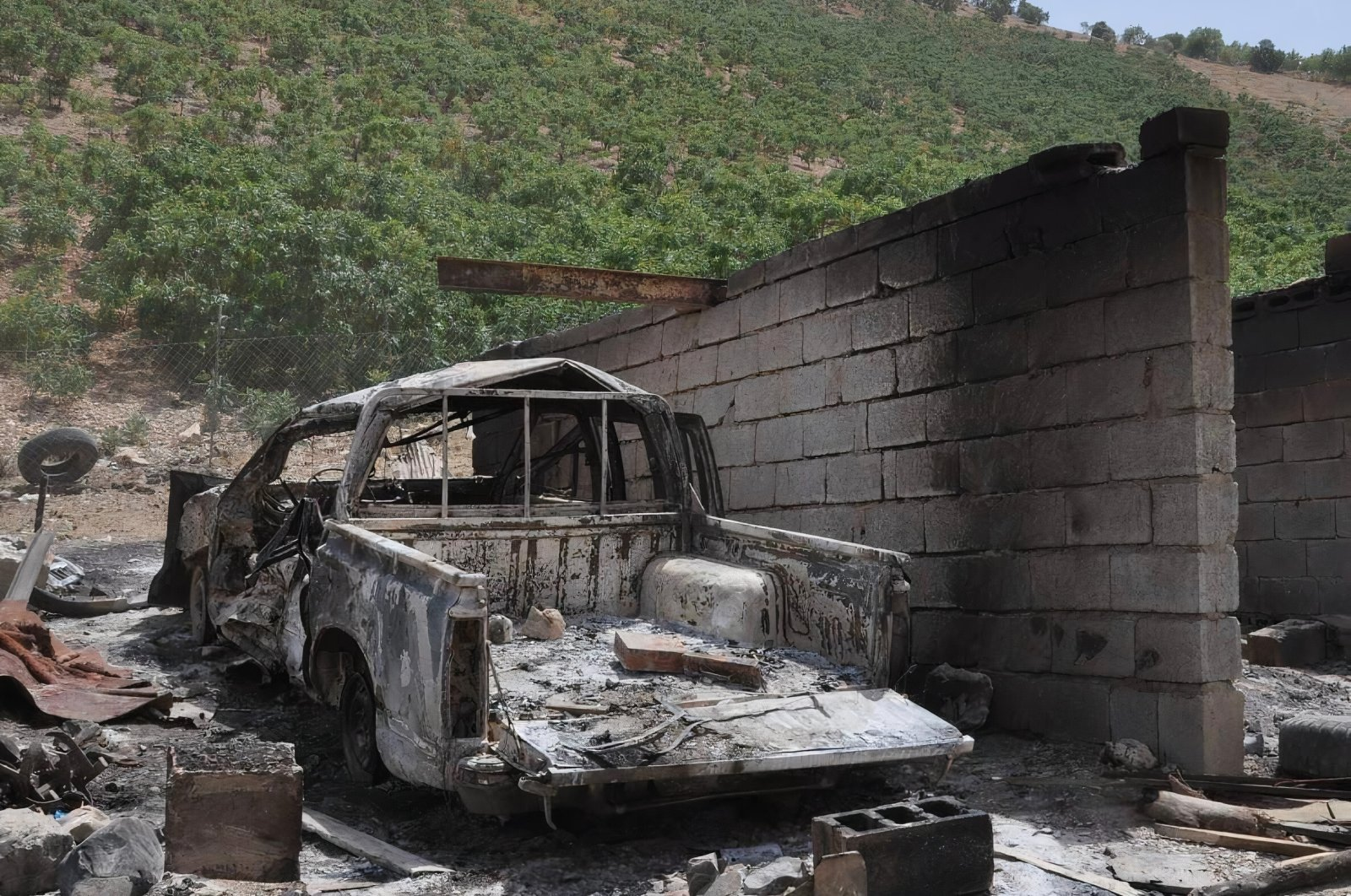 Remains of a vehicle are seen in Sulaymaniyah, northern Iraq, after PKK terrorists Mahiye Açık and Roha Racı were killed in a Turkish intelligence operation in this undated photo released on June 30, 2021. (AA Photo)