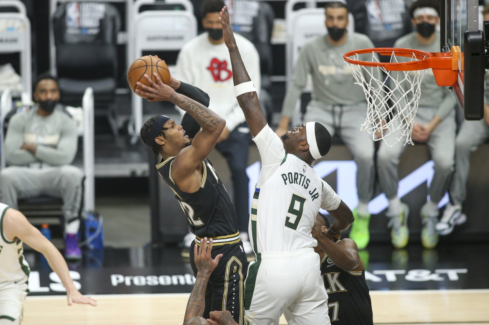 Atlanta Hawks forward Cam Reddish (L) shoots past Milwaukee Bucks center Bobby Portis during 2021 NBA Playoffs Eastern Conference Finals Game 4 at State Farm Arena, Atlanta, Georgia, U.S., Jun 29, 2021. (Reuters Photo)