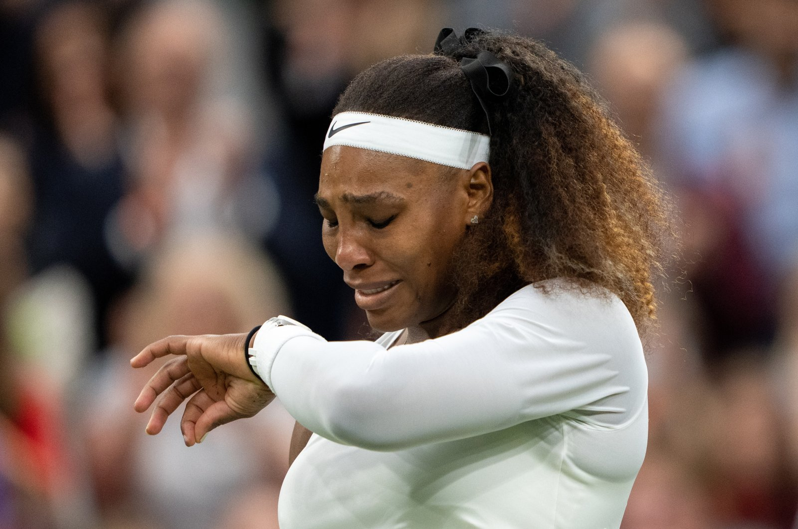 U.S.' Serena Williams in tears after sustaining an injury before retiring from her Wimbledon first-round match against Belarus' Aliaksandra Sasnovich All England Tennis Club, London, England, June 29, 2021. (Reuters Photo)