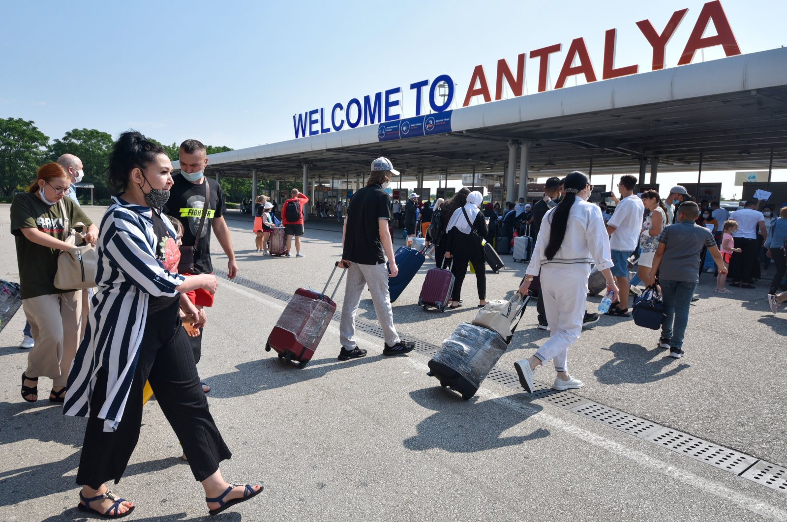 Russian tourists exit the airport as they arrive in Antalya, southern Turkey, June 29, 2021. (IHA Photo)