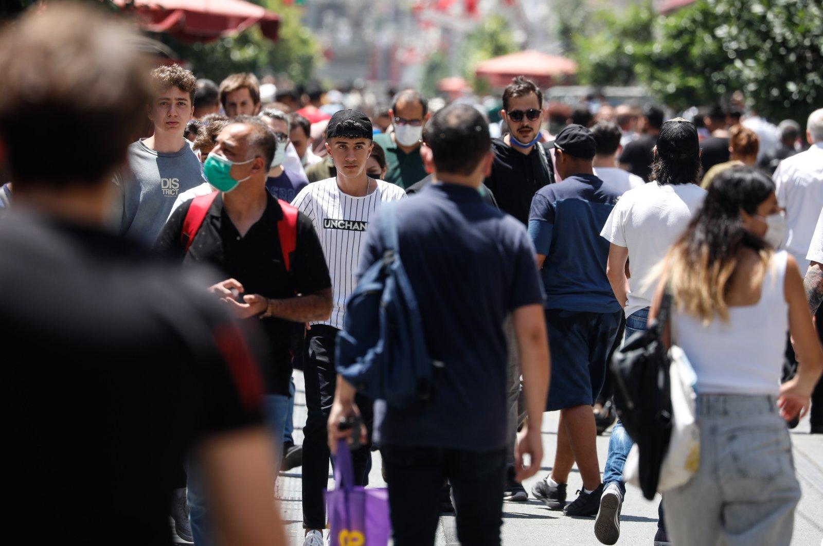 People walking on Istiklal Street, in Istanbul, Turkey, on June 28, 2021. (DHA Photo)