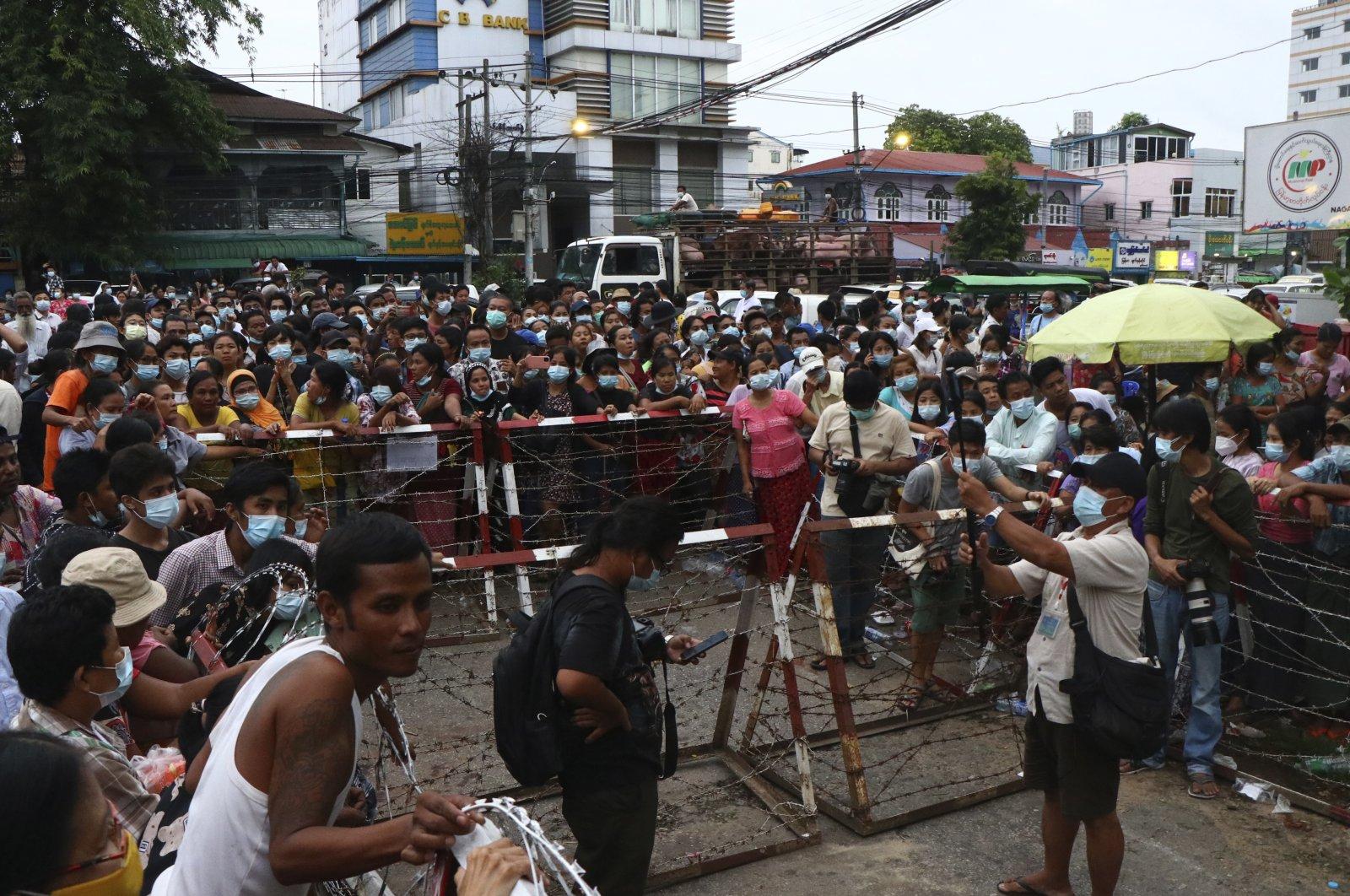 A crowd waits outside Insein Prison in Yangon, Myanmar Wednesday, June 30, 2021. (AP Photo)