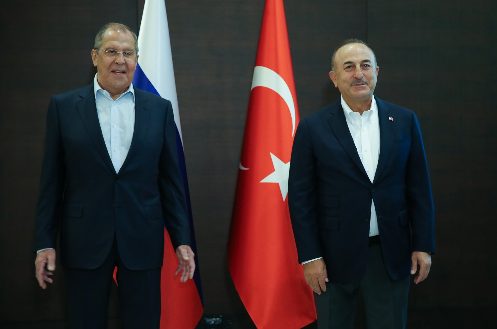 Turkish Foreign Minister Mevlüt Çavuşoğlu (R) and his Russian counterpart Sergey Lavrov pose for a photo before a press conference in Antalya, Turkey, June 30, 2021. (AA Photo)