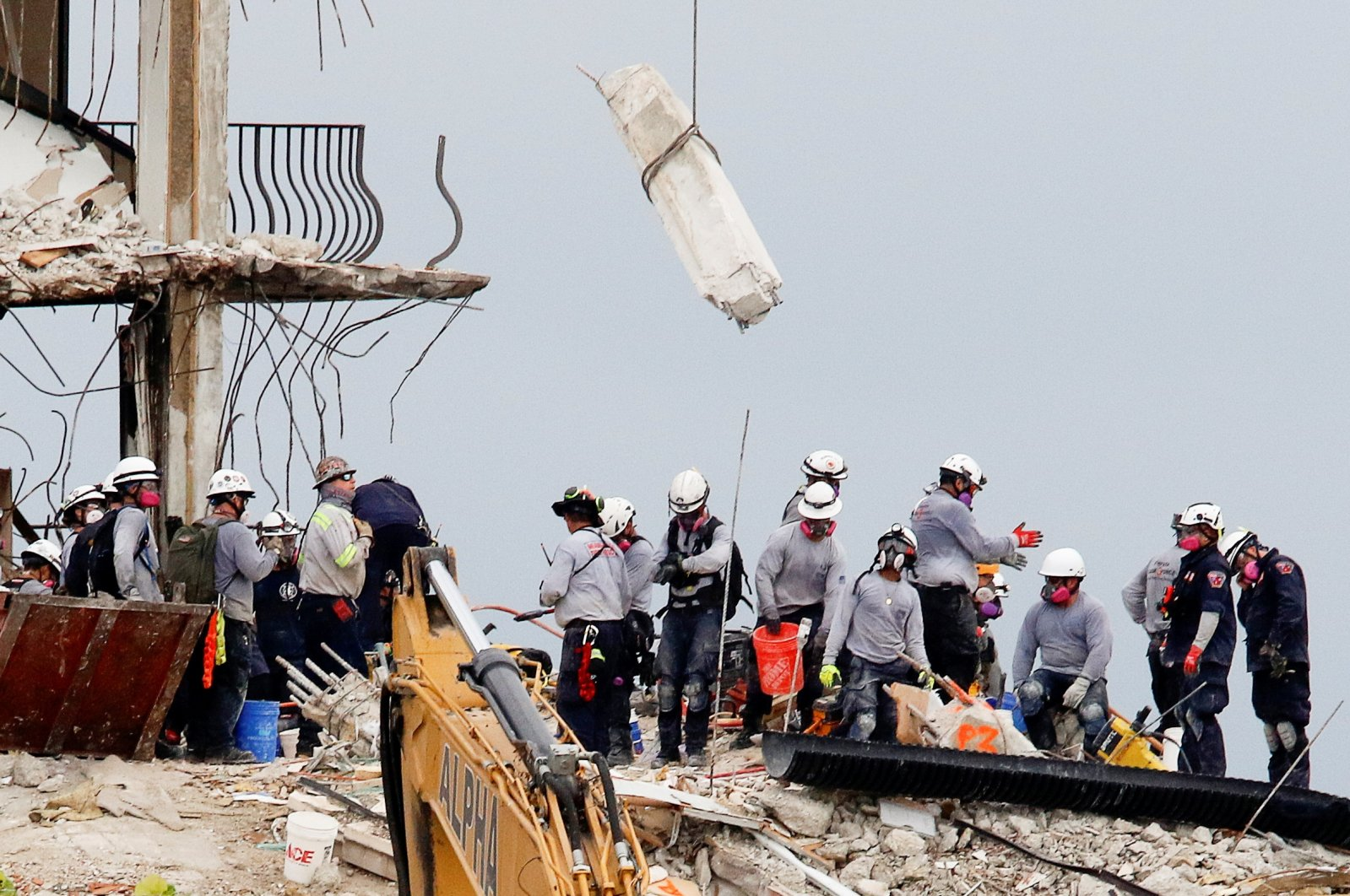 Emergency workers conduct search and rescue efforts at the site of a partially collapsed residential building in Surfside, Florida, U.S., June 30, 2021. (Reuters Photo)