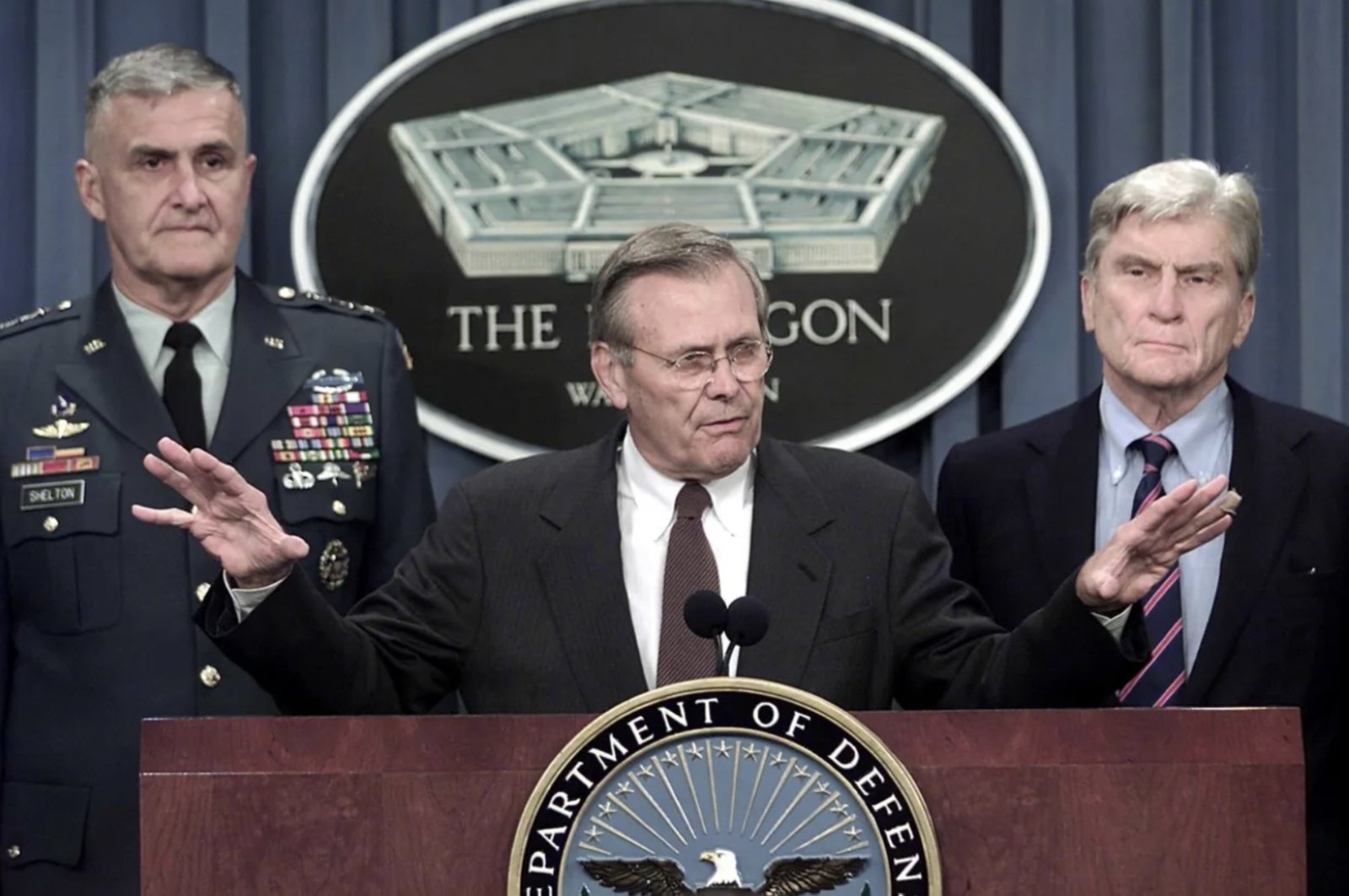 Then-Secretary of Defense Donald Rumsfeld (C) speaks during a press conference held jointly with former U.S. Joint Chief of Staff General Hugh Shelton (L) and former U.S. Senator John Warner (R) after terrorists attacked the World Trade Center and Pentagon, Washington, D.C., U.S. Sept. 11, 2001. (AFP File Photo)