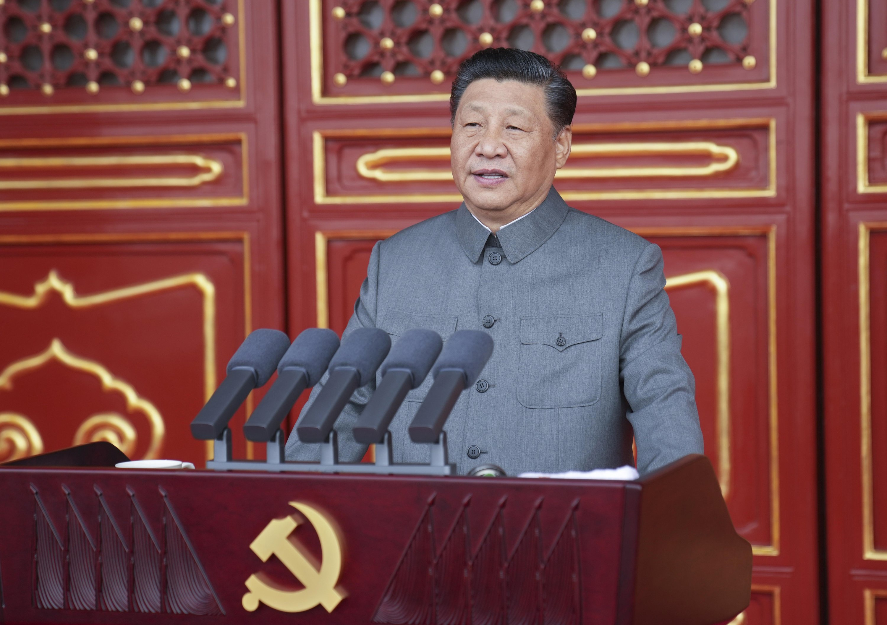 In this photo provided by China's Xinhua News Agency, Chinese President and party leader Xi Jinping delivers a speech at a ceremony marking the centenary of the ruling Communist Party in Beijing, China, July 1, 2021. (Xinhua via AP)