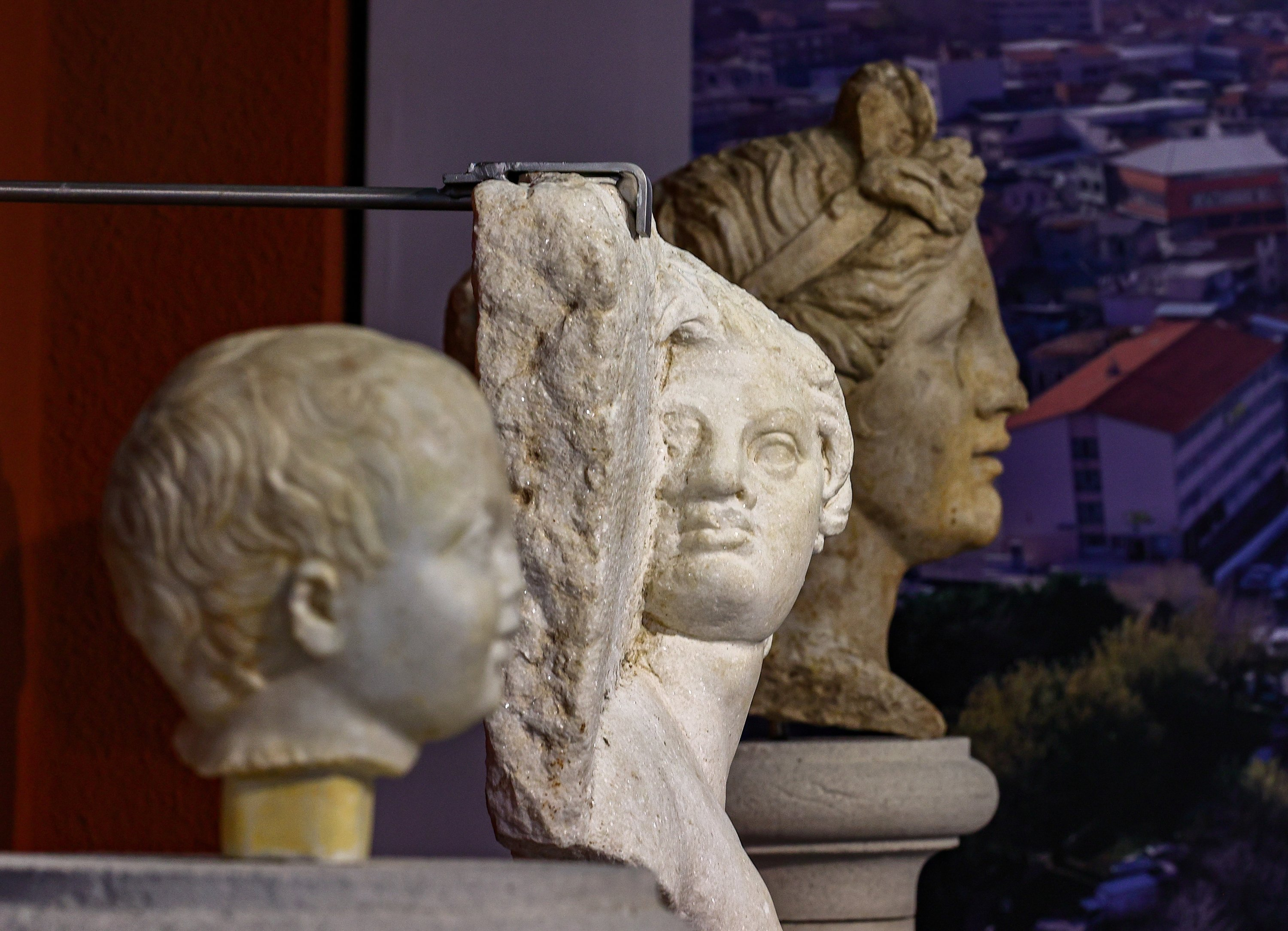 A baby head (L), the satyr relief (C) and the head of a woman, which was the first statue found in Smyrna, on display at Izmir Archaeological Museum, Izmir, western Turkey, June 30, 2021. (AA Photo)