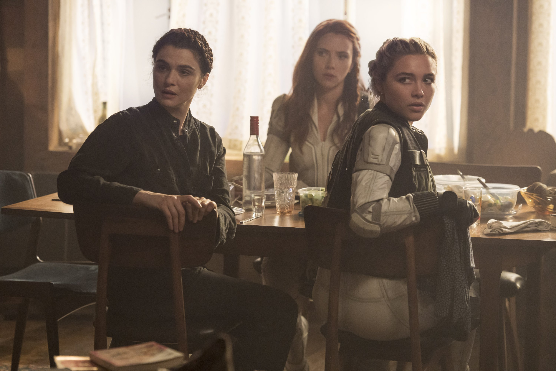 Rachel Weisz (L), Scarlett Johansson (C) and Florence Pugh turn to look at someone, in a scene from Marvel superhero film 'Black Widow.' (Disney via AP)