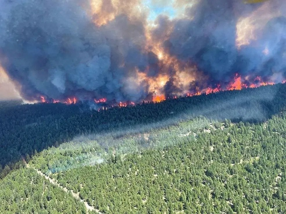 This handout photo courtesy of the British Columbia Wildfire Service shows the Sparks Lake wildfire, British Columbia, seen from the air on June 29, 2021. (BC Wildfire Service / AFP)