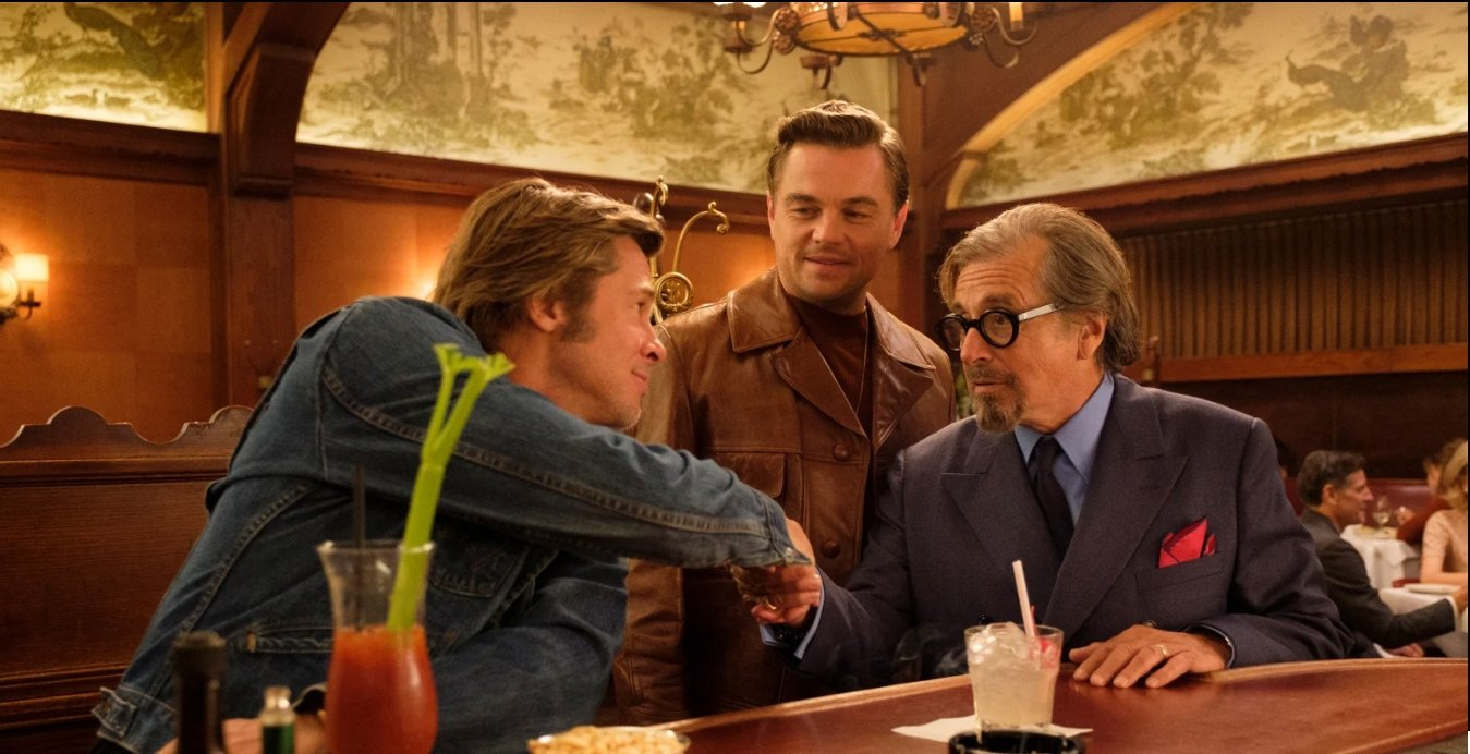 A still shot from 'Once Upon a Time in Hollywood' shows Brad Pitt (L), Leonardo Di Caprio (C) and Al Pacino together in a scene.