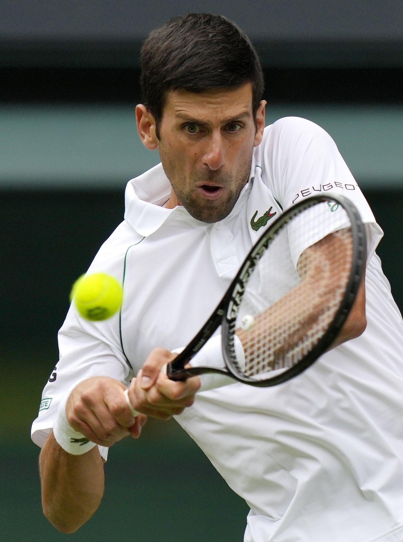 Serbia's Novak Djokovic plays a return to South Africa's Kevin Anderson during the 2021 Wimbledon men's singles second round match at The All England Tennis Club in Wimbledon, southwest London, England, June 30, 2021. (AFP Photo)