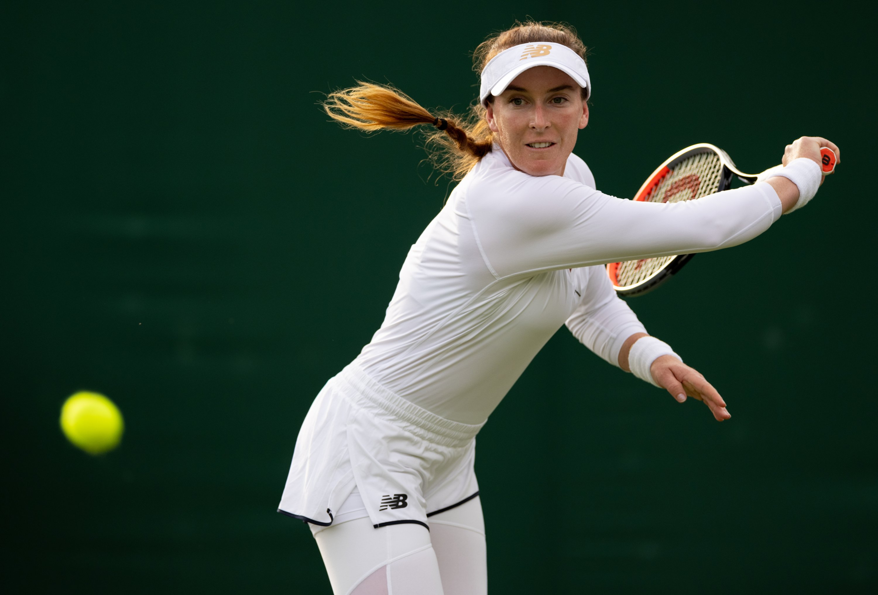 U.S.' Madison Brengle in action during her 2021 Wimbledon women's singles match against compatriot Sofia Kenin at The All England Tennis Club in Wimbledon, southwest London, England, June 30, 2021. (AFP Photo)