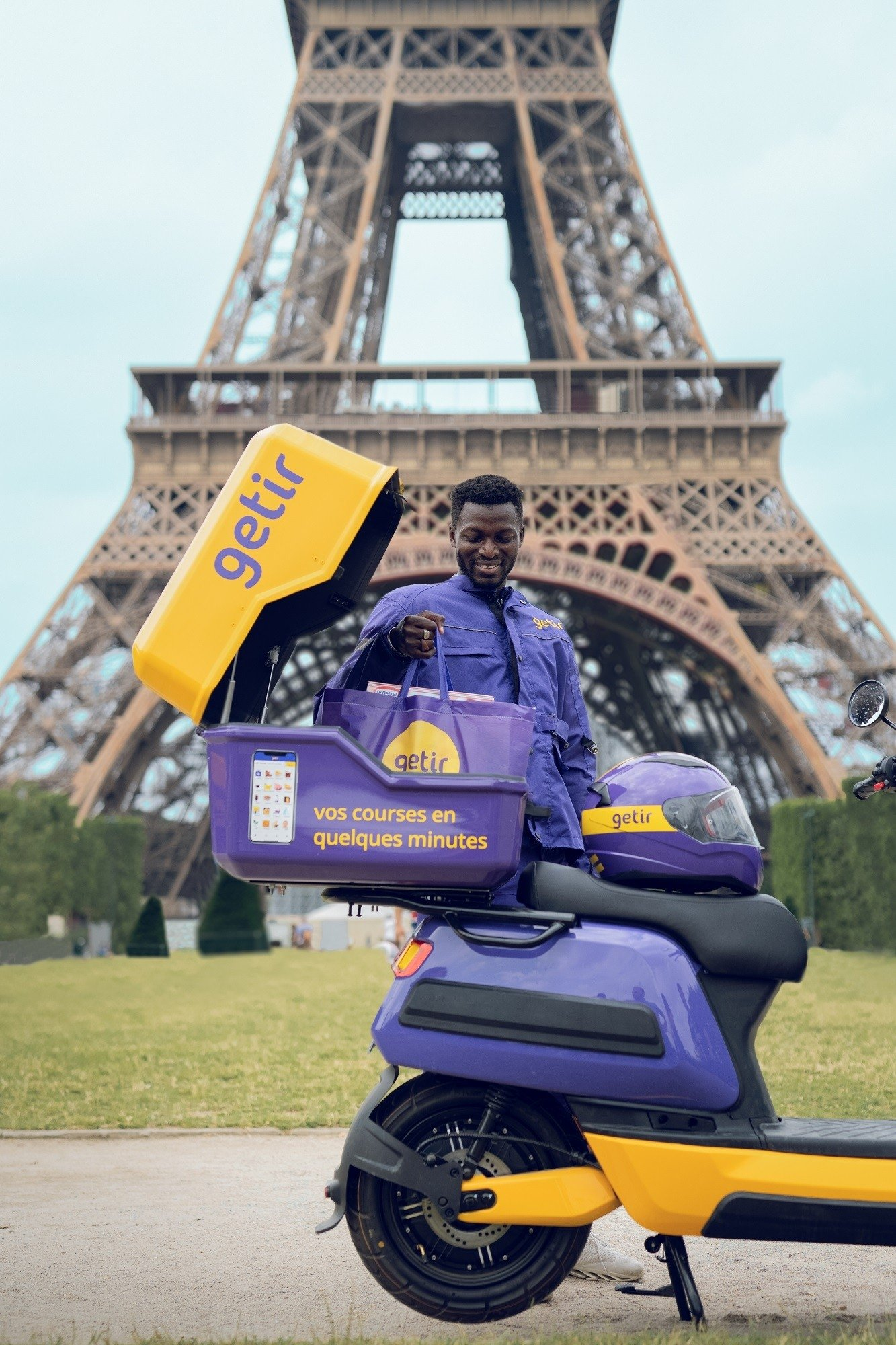A Getir courier poses for a photo near the Eiffel Tower in Paris, France, June 22, 2021. (IHA Photo)