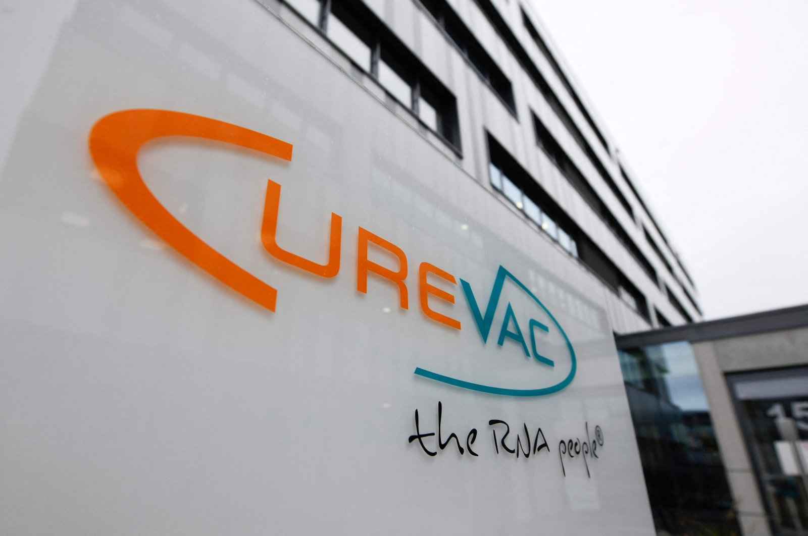The logo of the biopharmaceutical company CureVac is displayed in front of the company's headquarters in Tuebingen, southern Germany, Dec. 15, 2020.  (AFP File Photo)