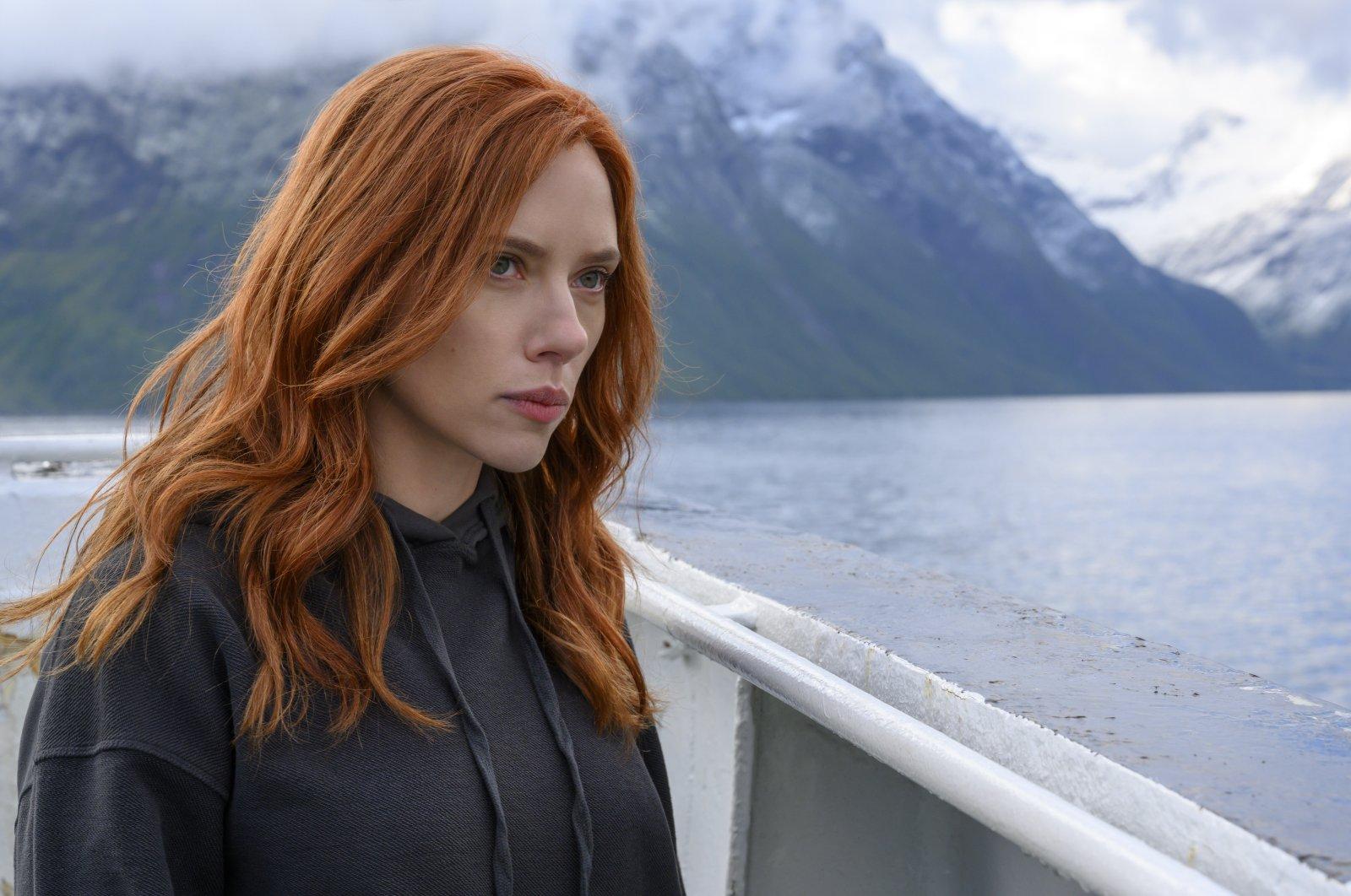 "Scarlett Johansson looks off into the distance in a scene from Marvel superhero film ""Black Widow."" (Disney via AP)"