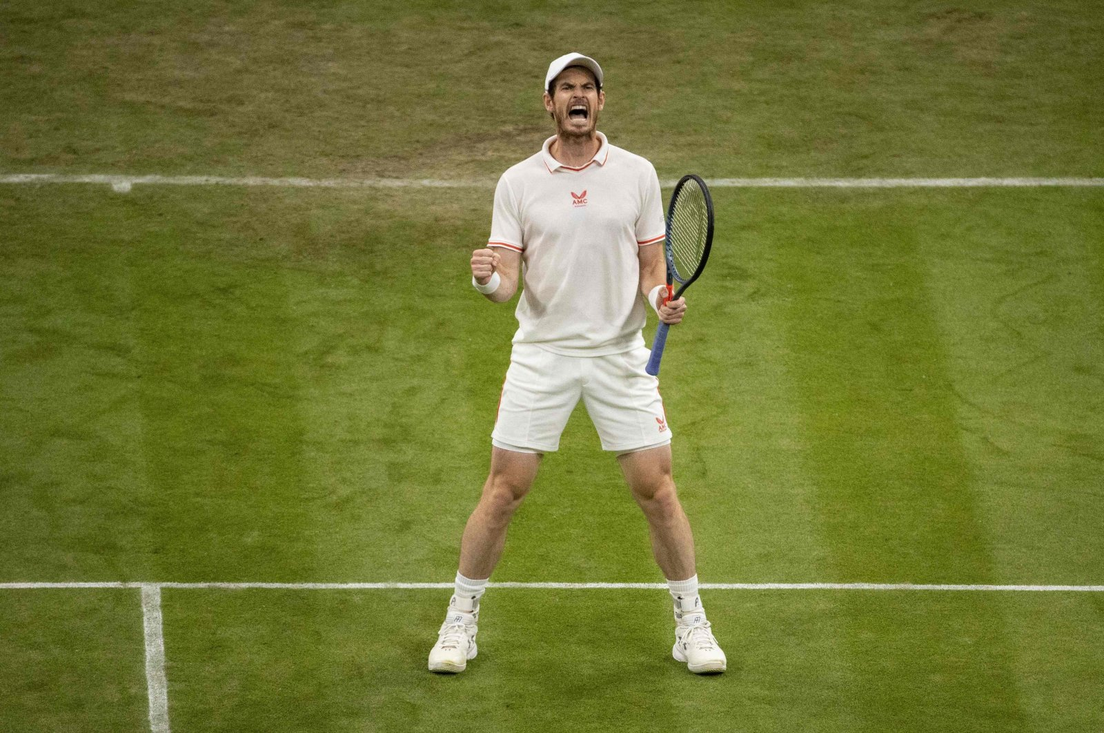 Britain's Andy Murray wins a point against Germany's Oscar Otte during the 2021 Wimbledon men's singles second-round match at The All England Tennis Club in Wimbledon, southwest London, England, June 30, 2021. (AFP Photo)