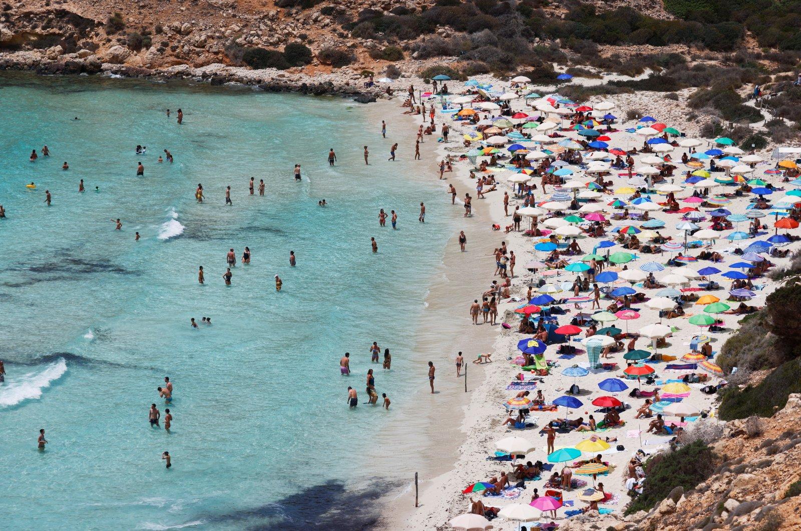People sunbathe on the beach on the Sicilian island of Lampedusa, in Lampedusa, Italy, June 22, 2021. (Reuters Photo)