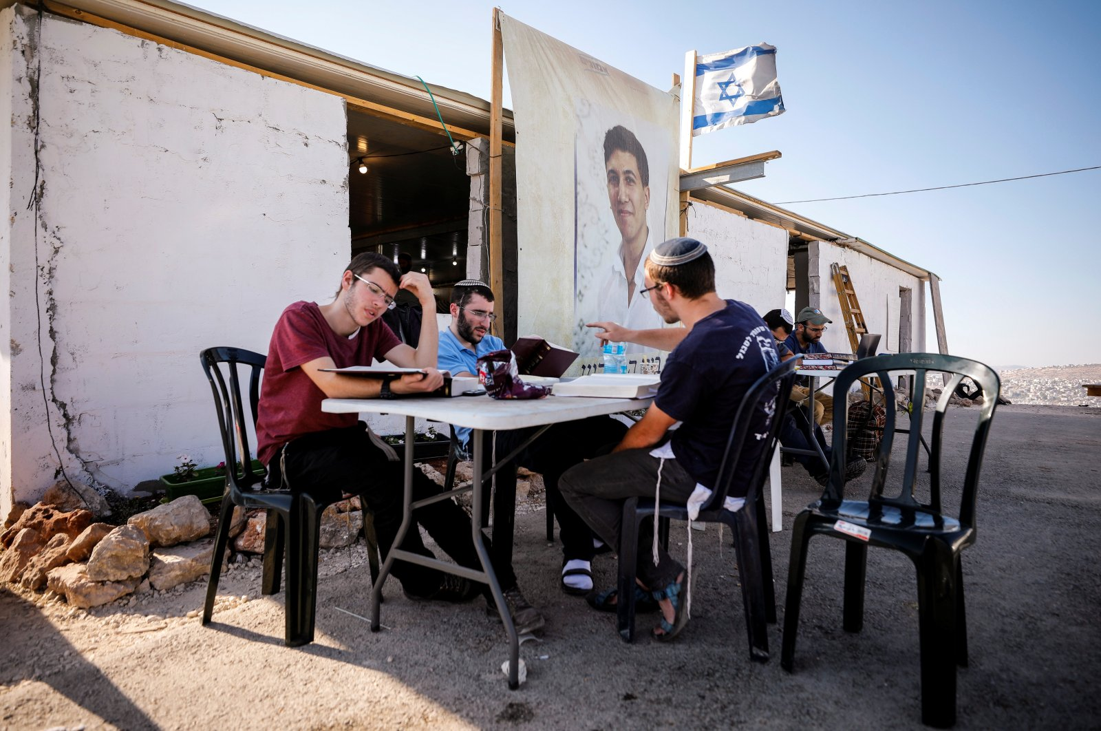 Jewish settlers study together in Givat Eviatar, a new Israeli settler outpost, near the Palestinian village of Beita in the Israeli-occupied West Bank June 23, 2021. (Reuters Photo)