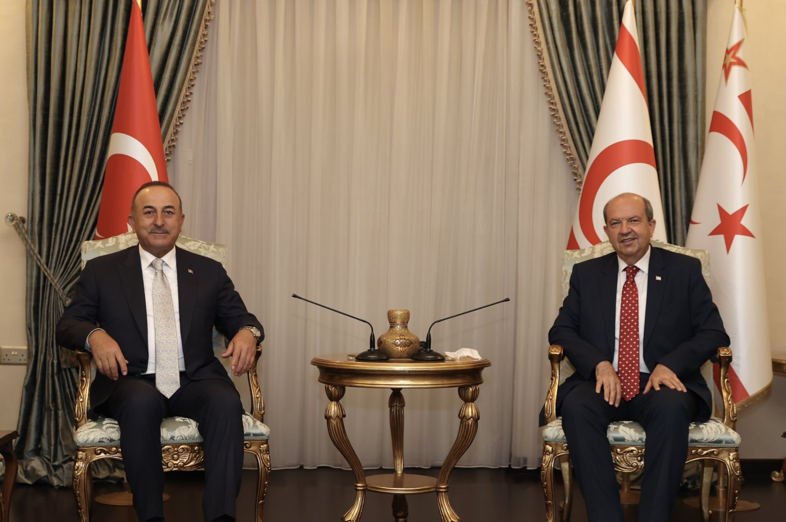 Turkey's Foreign Minister Mevlüt Çavuşoğlu (L) and TRNC President Ersin Tatar meet in Lefkoşa (Nicosia), TRNC, July 1, 2021. (AA Photo)