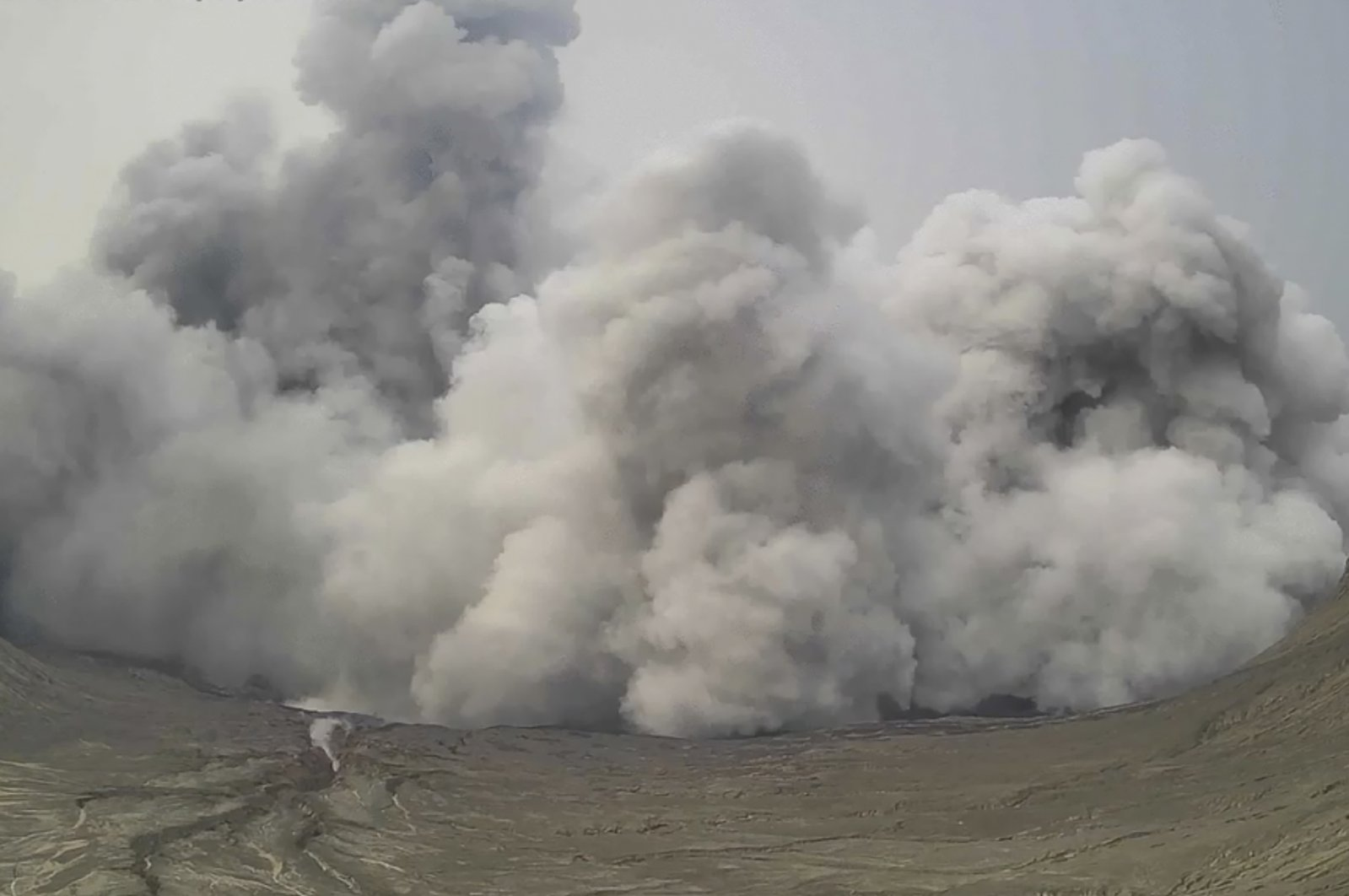 An image from a video shows a plume of steam and ash rise from Taal Volcano, Batangas province, Philippines, July 1, 2021. (AP Photo)