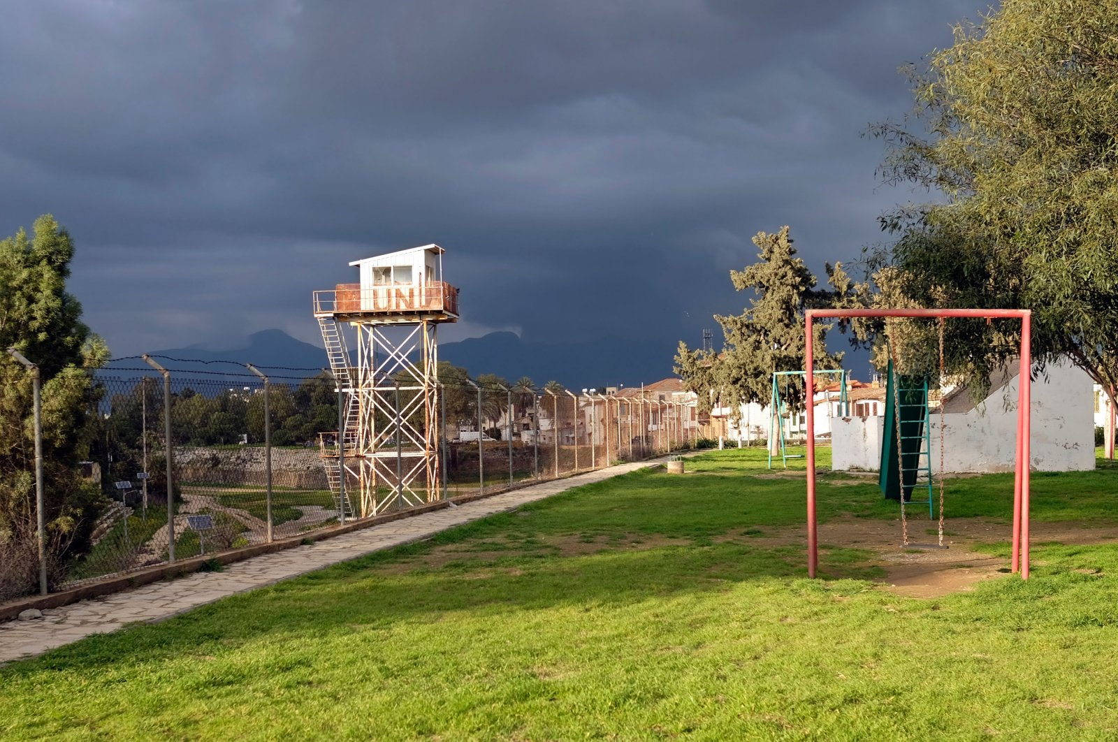 """United Nations guard tower in the """"Green Line"""" between the North and South of Nicosia, Cyprus next to a playground, Feb. 20, 2020. (Shutterstock File Photo)"""