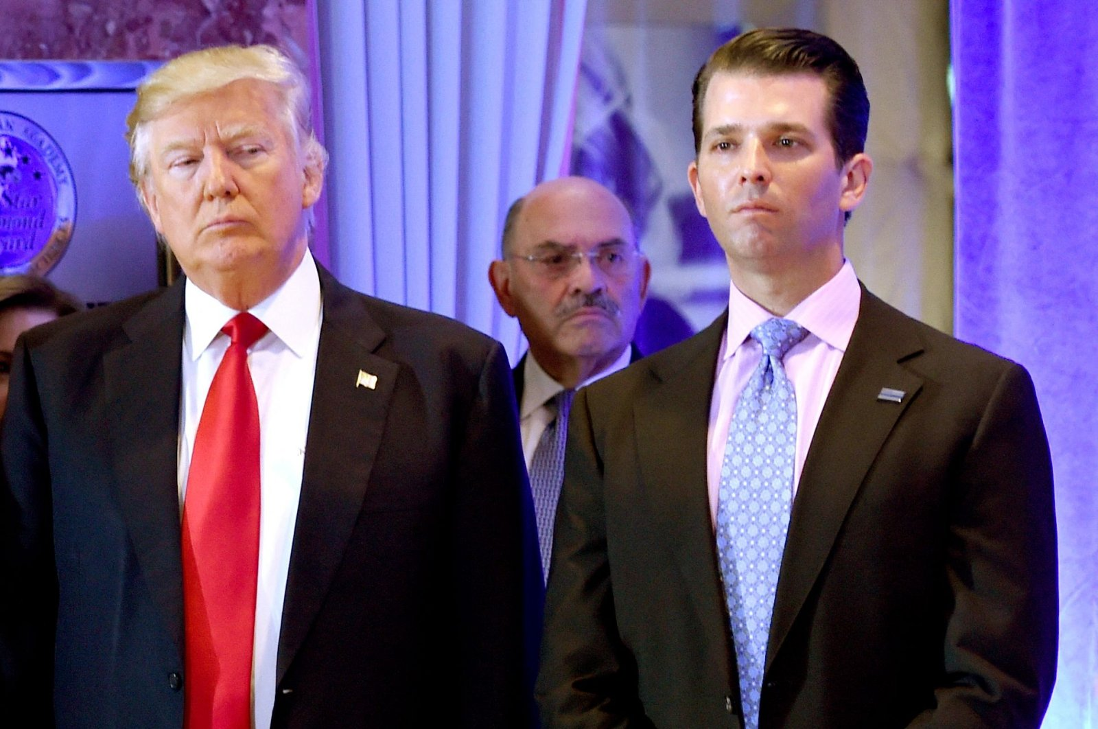 Former U.S. President Donald Trump and his son Donald, Jr., arrive for a press conference at Trump Tower in New York, as Allen Weisselberg (C), chief financial officer of The Trump Organization, looks on, New York, U.S., Jan. 11, 2017. (AFP Photo)
