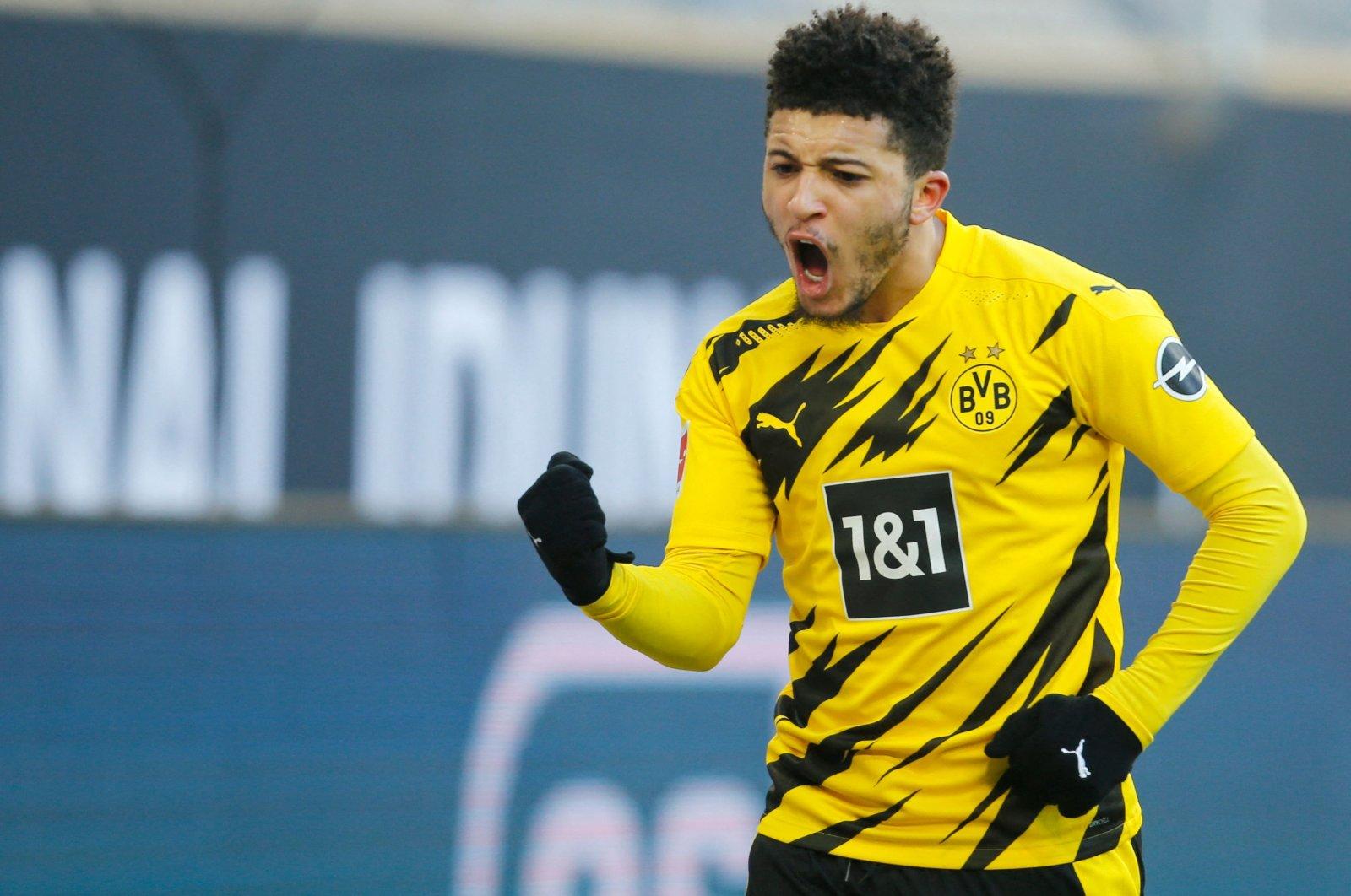 Dortmund's English midfielder Jadon Sancho celebrates after scoring during a Bundesliga match against TSG 1899 Hoffenheim in Dortmund, western Germany, Feb. 13, 2021. (AFP Photo)