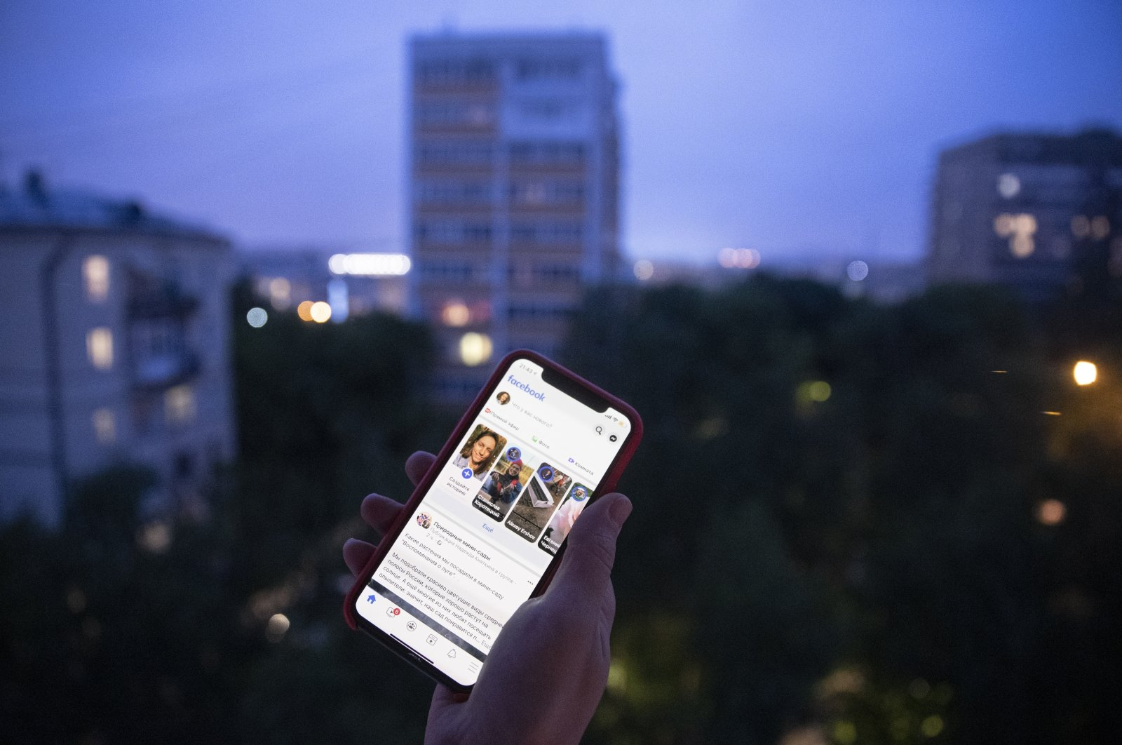 A user holds a smartphone with an opened Facebook page in Moscow, Russia, June 10, 2021. (AP Photo)