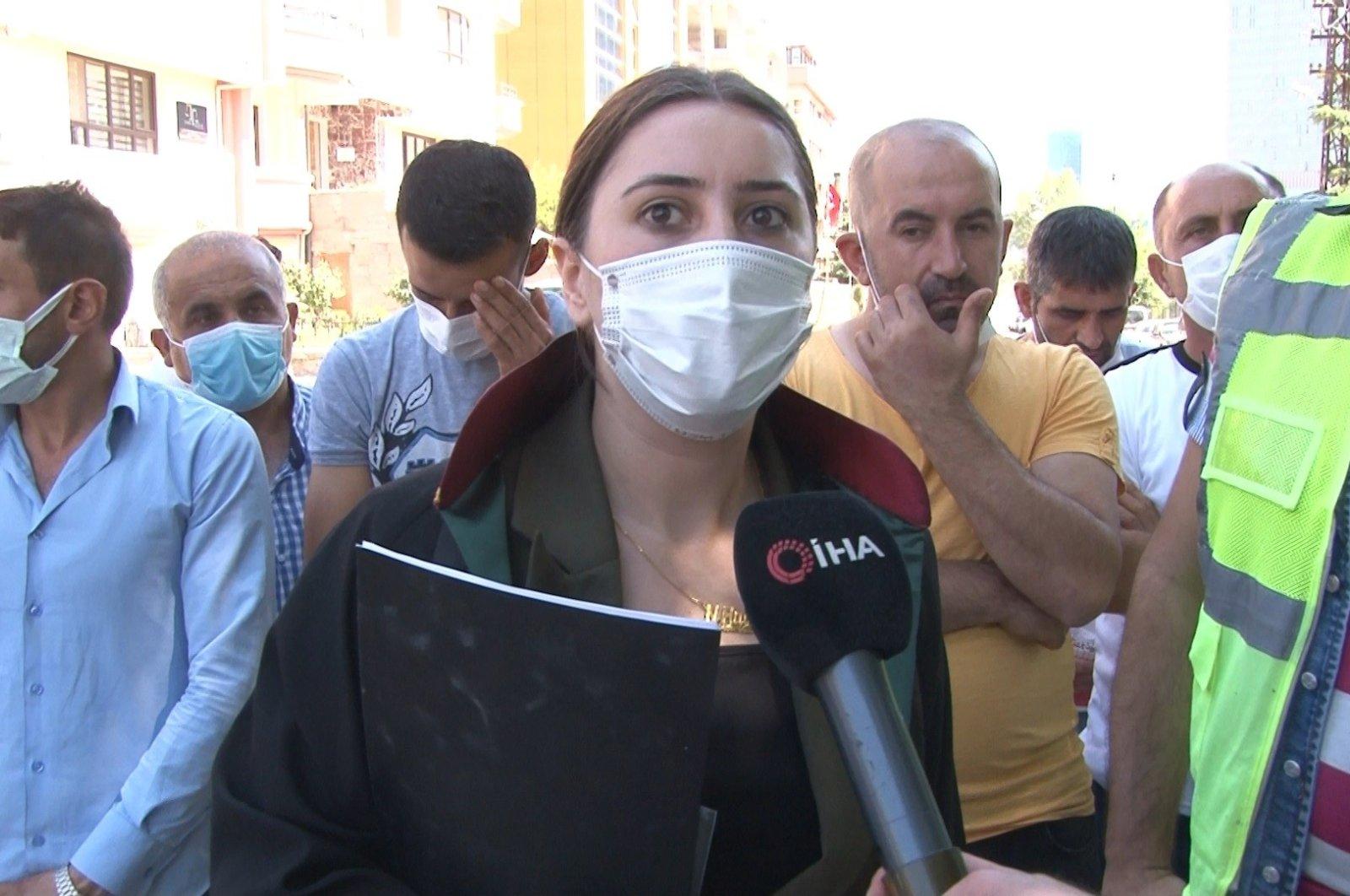 Lawyer Havvanur Gölveren speaks to Ihlas News Agency (IHA) on the employees' dismissal, Ankara, Turkey, July 1, 2021. (IHA Photo)